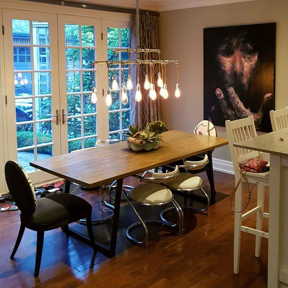 Decorating the dining room with large abstract original portrait in Toronto.