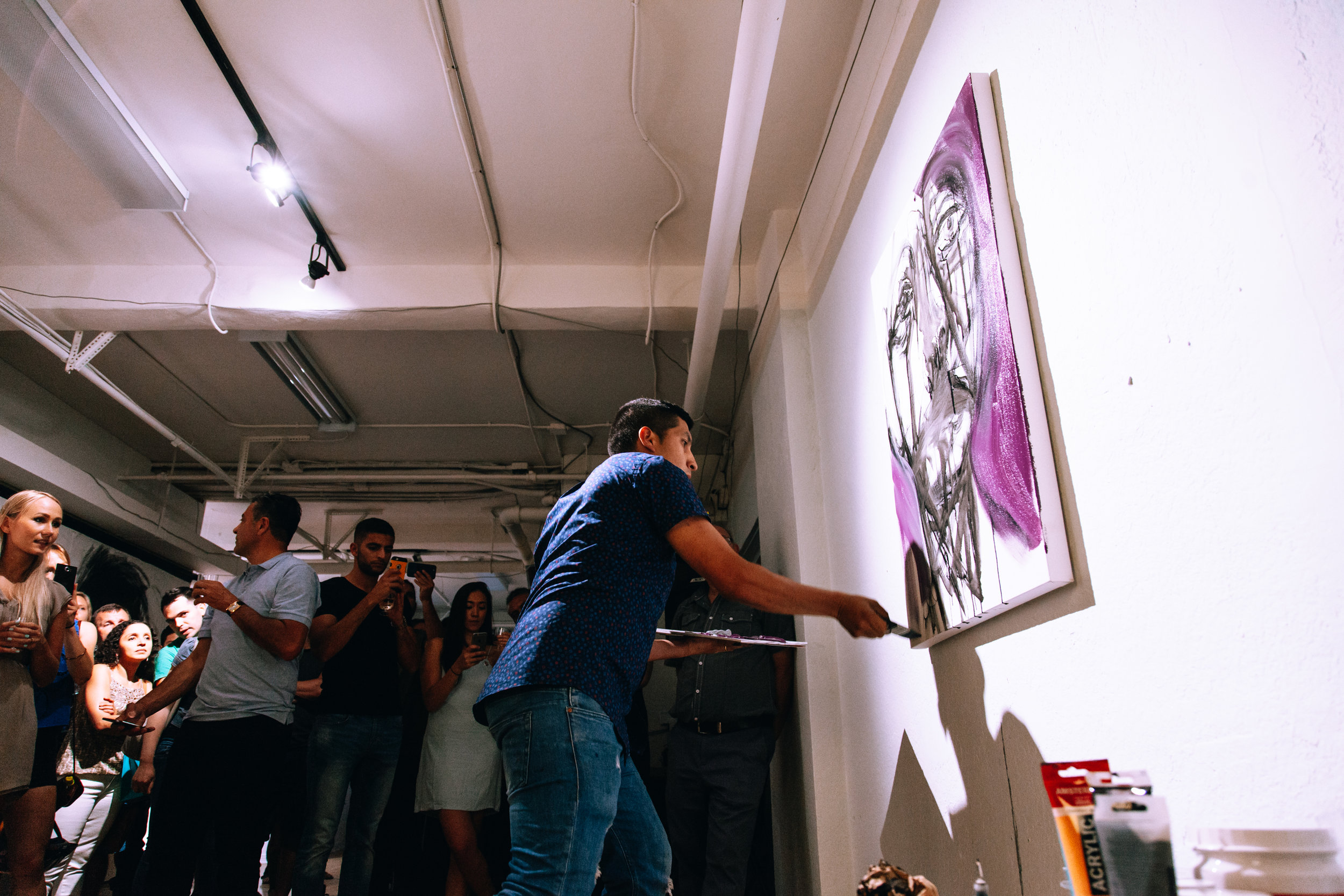 Live art activation at art show of abstract portraits by Colombian born, Toronto based artist Carlos Delgado in downtown Toronto at Orchid Signs.