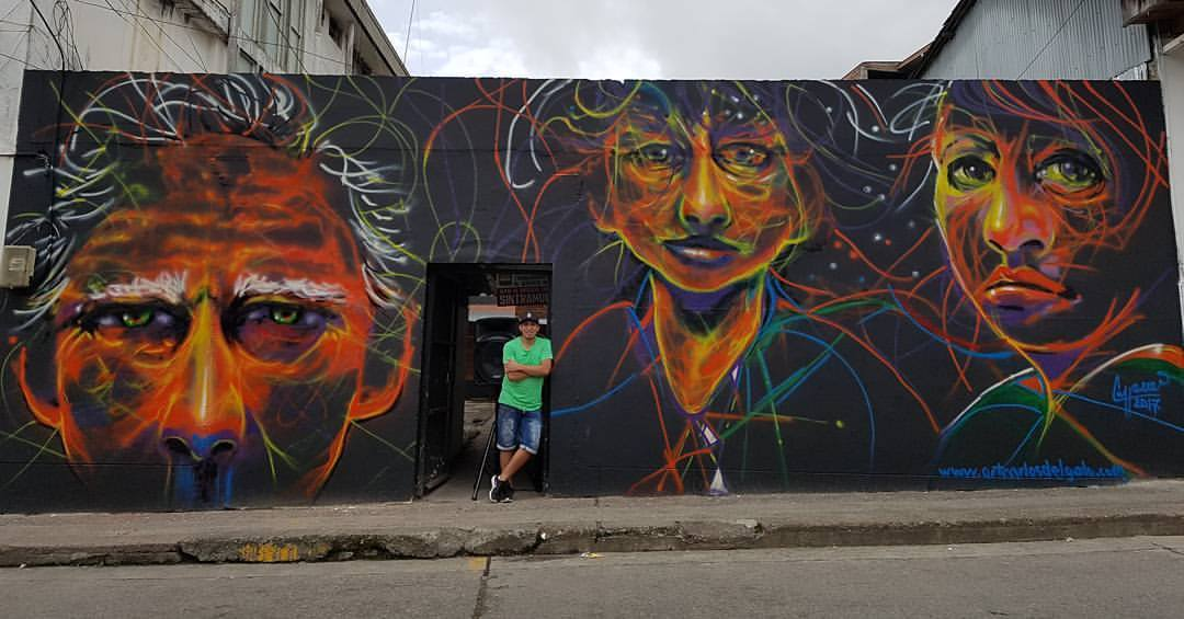 With finished large scale mural and street art in Riosucio, Caldas, Colombia.