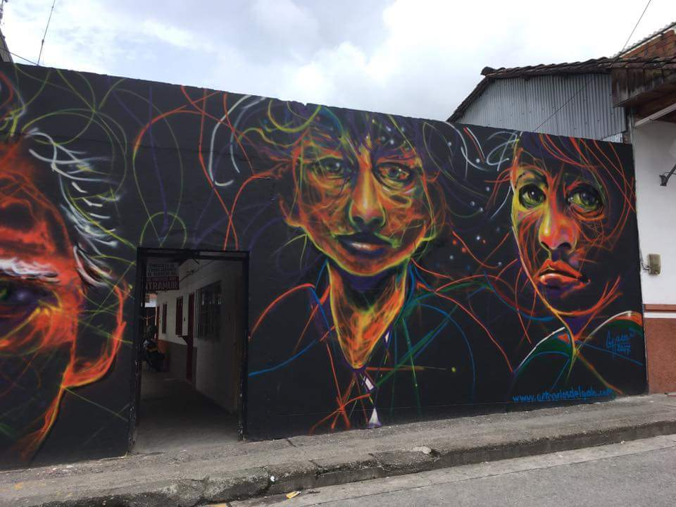 Large faces in this mural painted in summer 2017 in Colombia.
