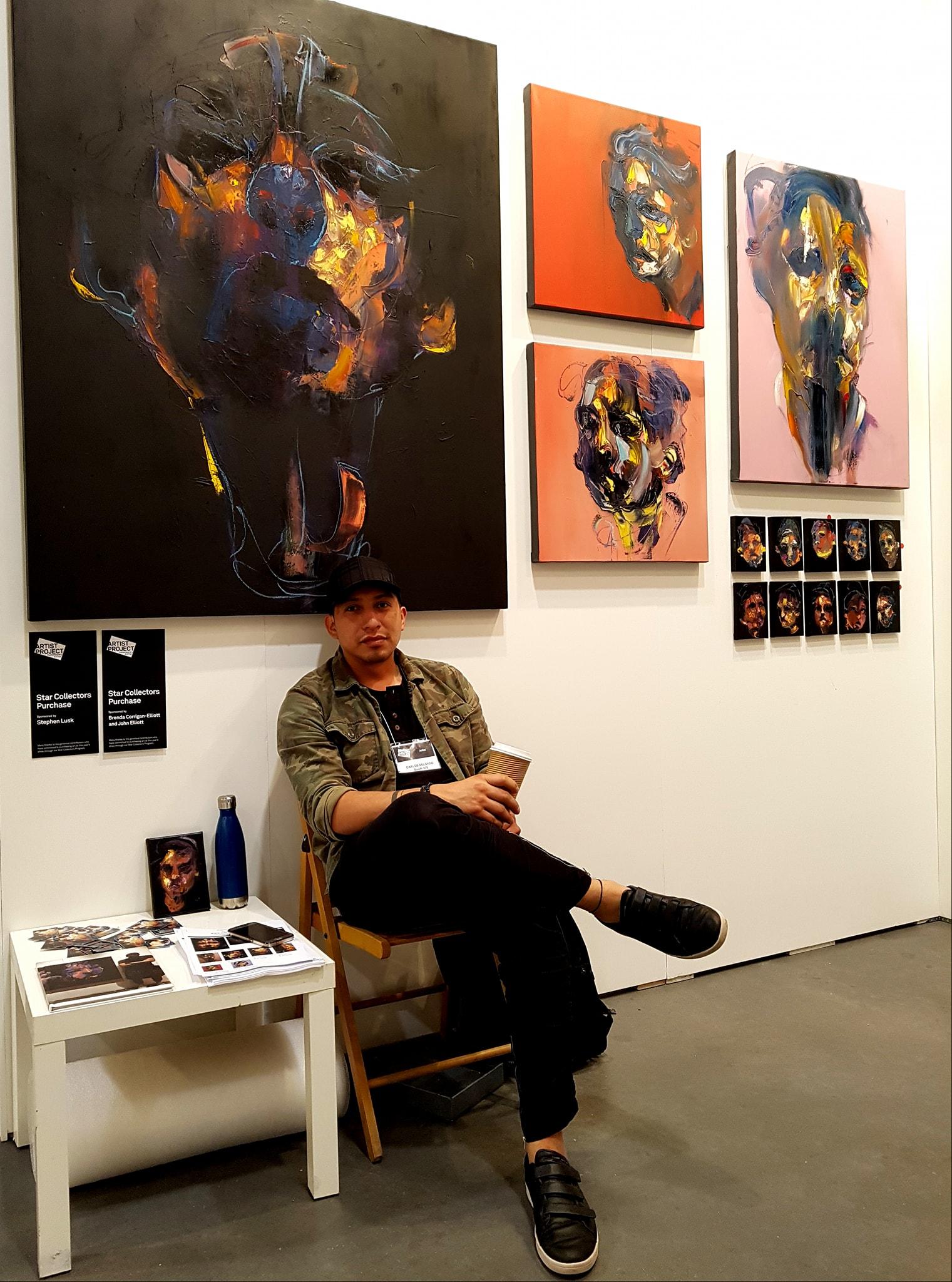 Close up of abstract portraits by Carlos Delgado at art fair in Toronto