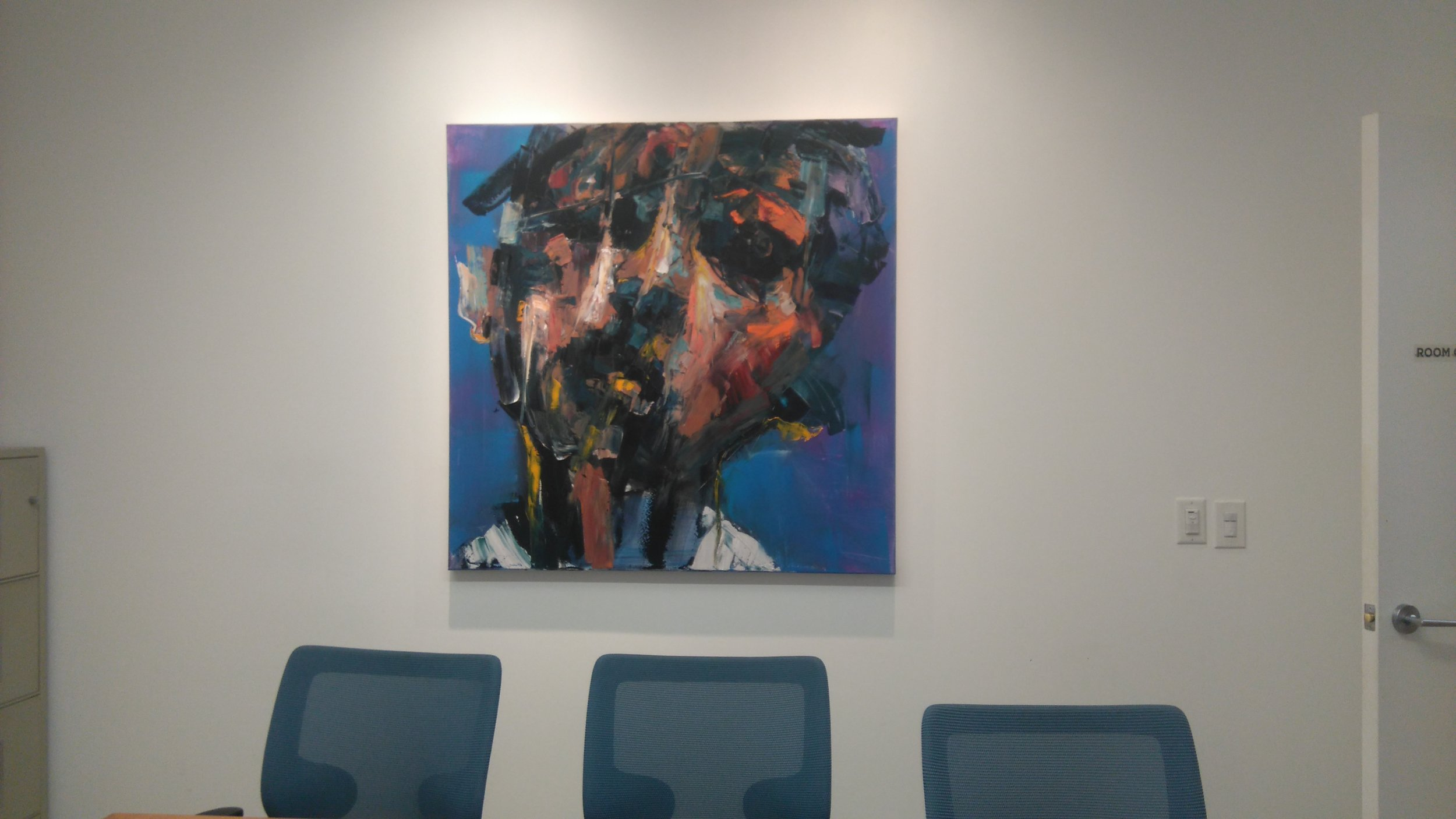 Abstract portrait hanging in the boardroom of Toronto Arts Foundation office in Toronto