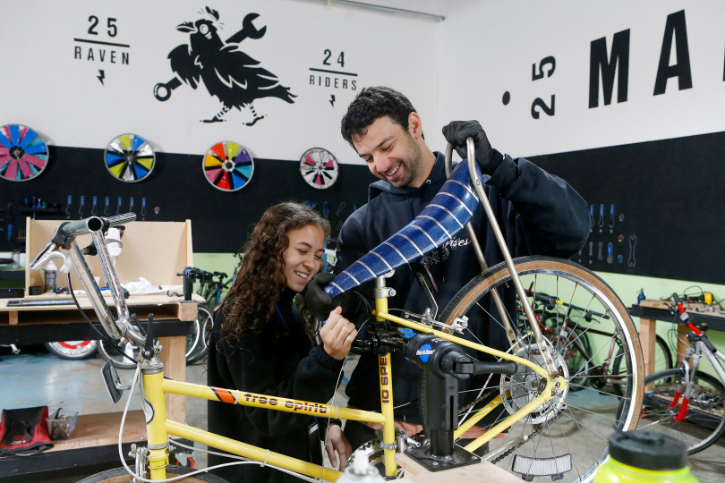 The new repair and custom bike shop is a teaching tool, its organizers say -