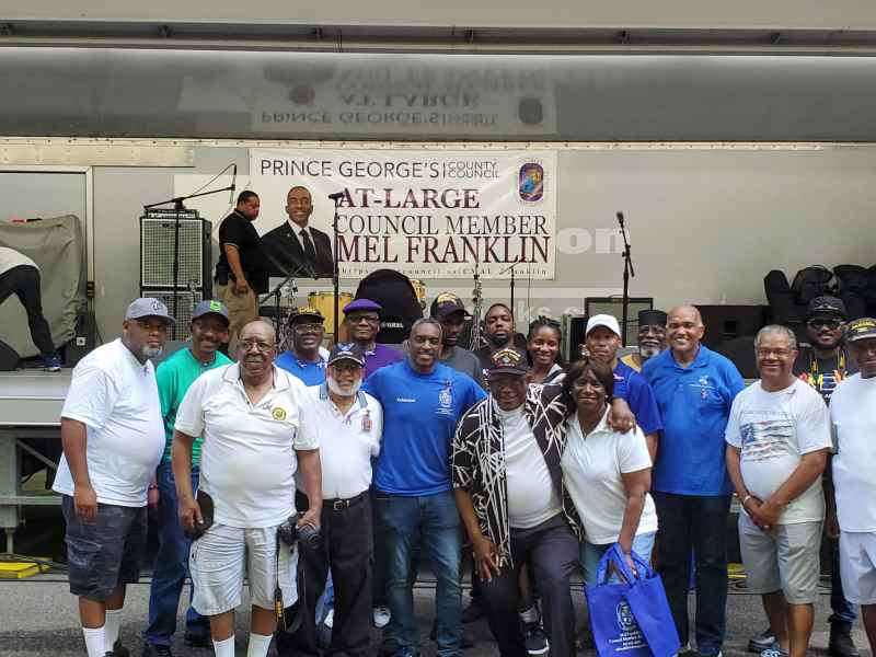 Mel Franklin (at center) with staff, supporters, community leaders and residents. PHOTO: KAREN MCCONNELL-JONES