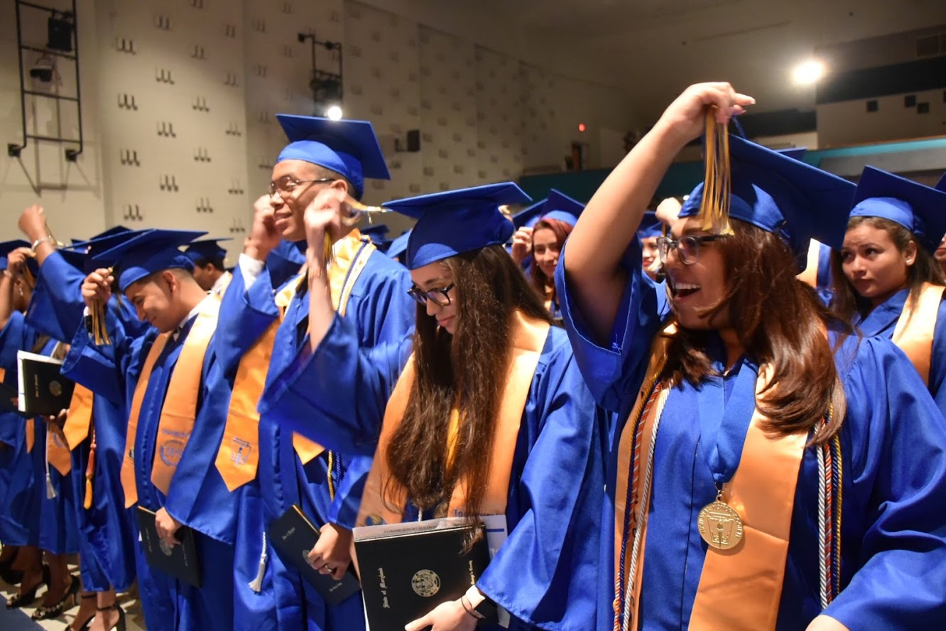 International High School at Langley Park 2019 graduating class. Katya Miranda (far right) moves her tassel to the graduate position at the final announcement to the class.