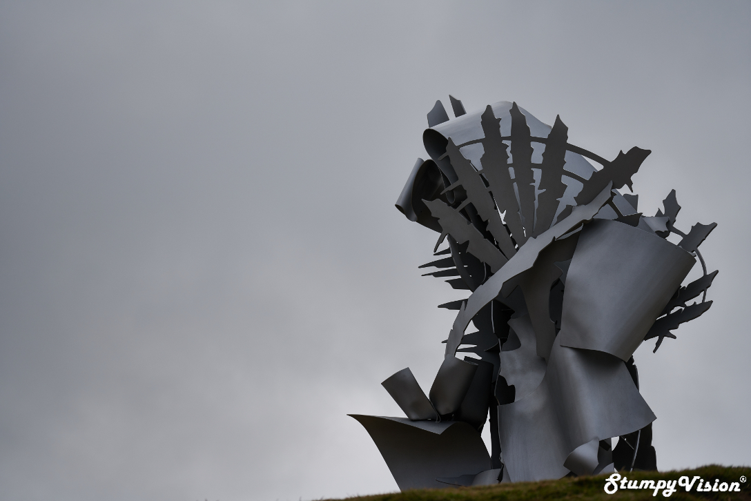 Albert Paley,  Languorous Repose . I love how this steam punk esque sculpture ominously compliments the moody grey sky backdrop.