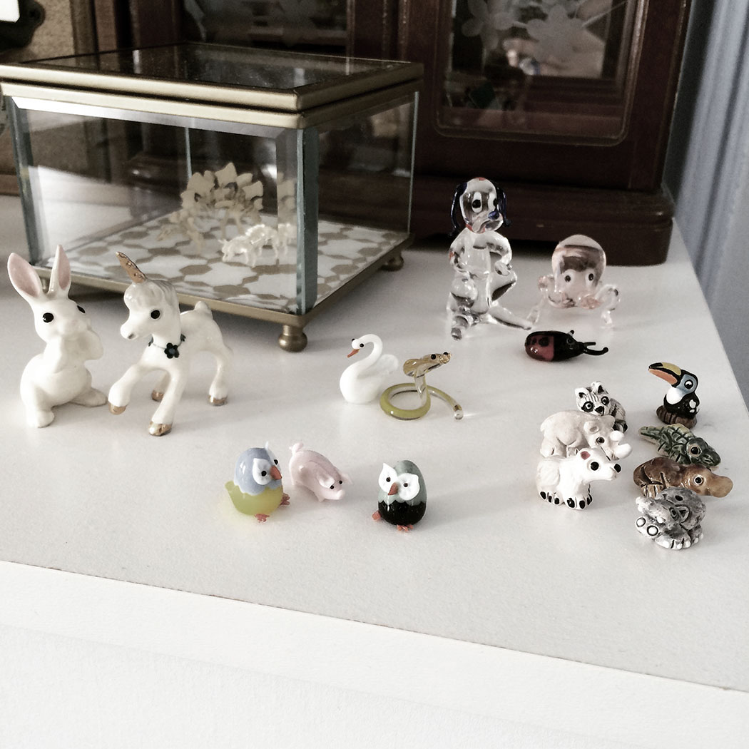 We used to collect these little ceramic and glass things together. The tinier the better. I can't believe they're still on display. I remember where each of these came from.