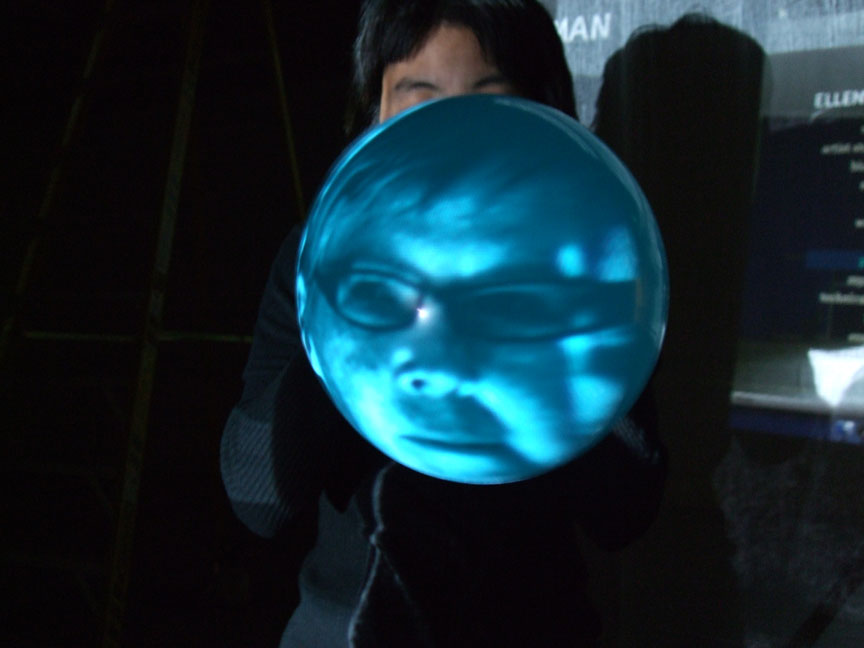 Live video of Fullman's face reading cast members' dream descriptions, projected onto balloons repeatedly blown up and released to fly away