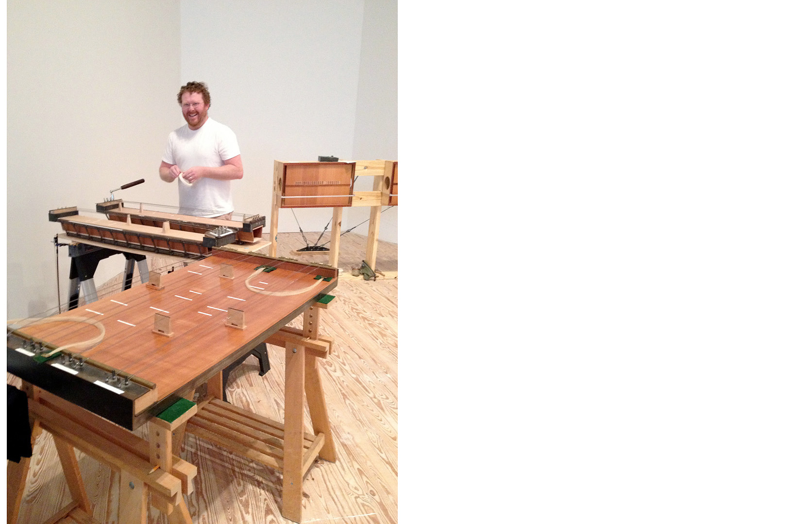 """Travis Weller setting up his """"Owl"""" (foreground) and """"Skiffs"""""""