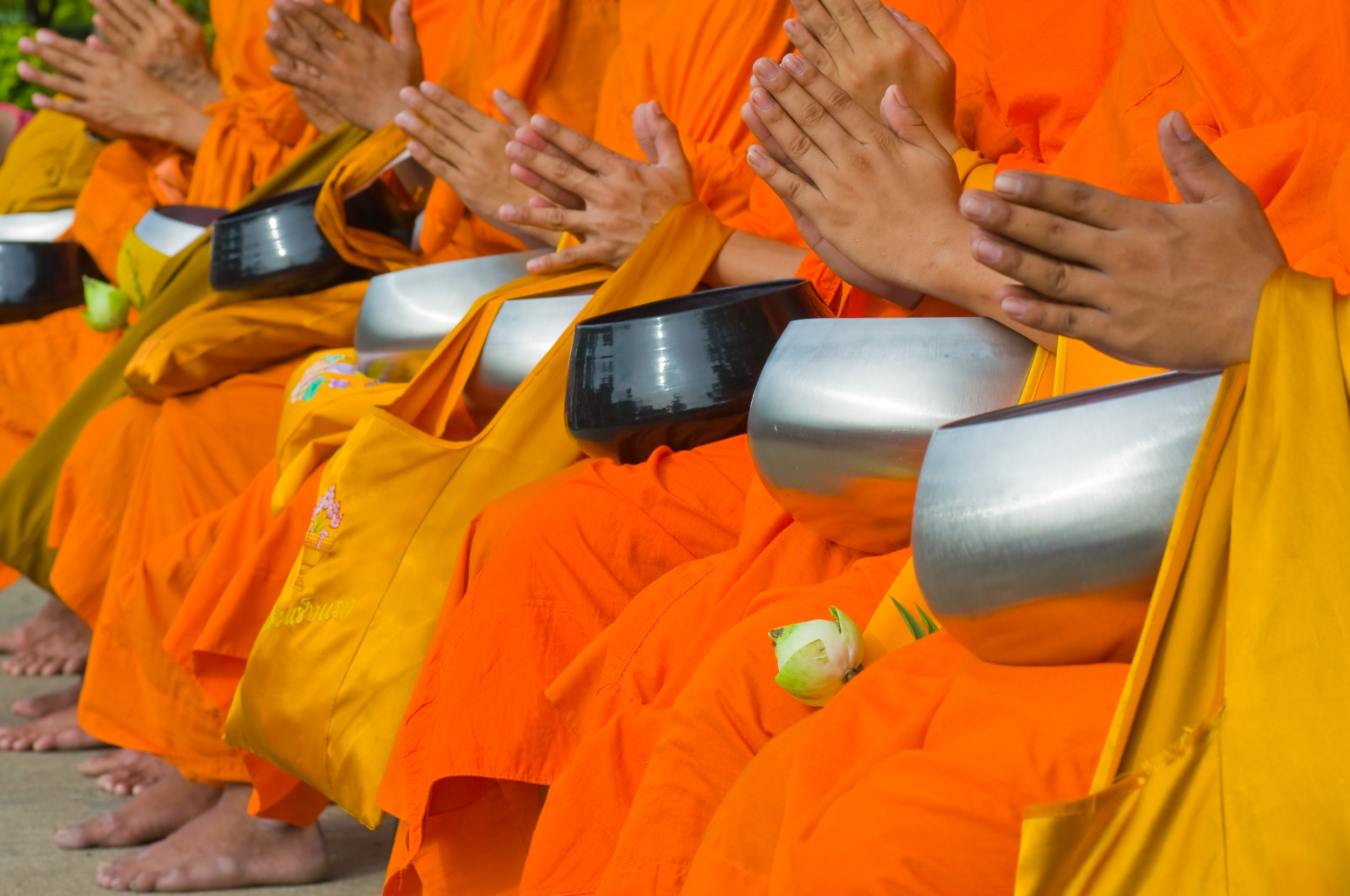 Monks receiving alms
