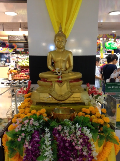 These little shrines will be set up in public places, like the Subway station, an apartment's front office, or the supermarket (above) so that Buddhists can make merit for Songkran by washing the statue with holy water