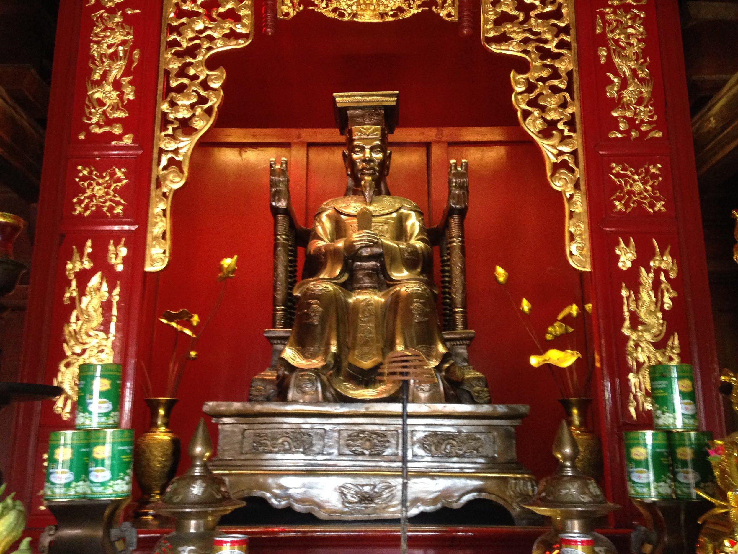 a statue at hanoi's temple of literature