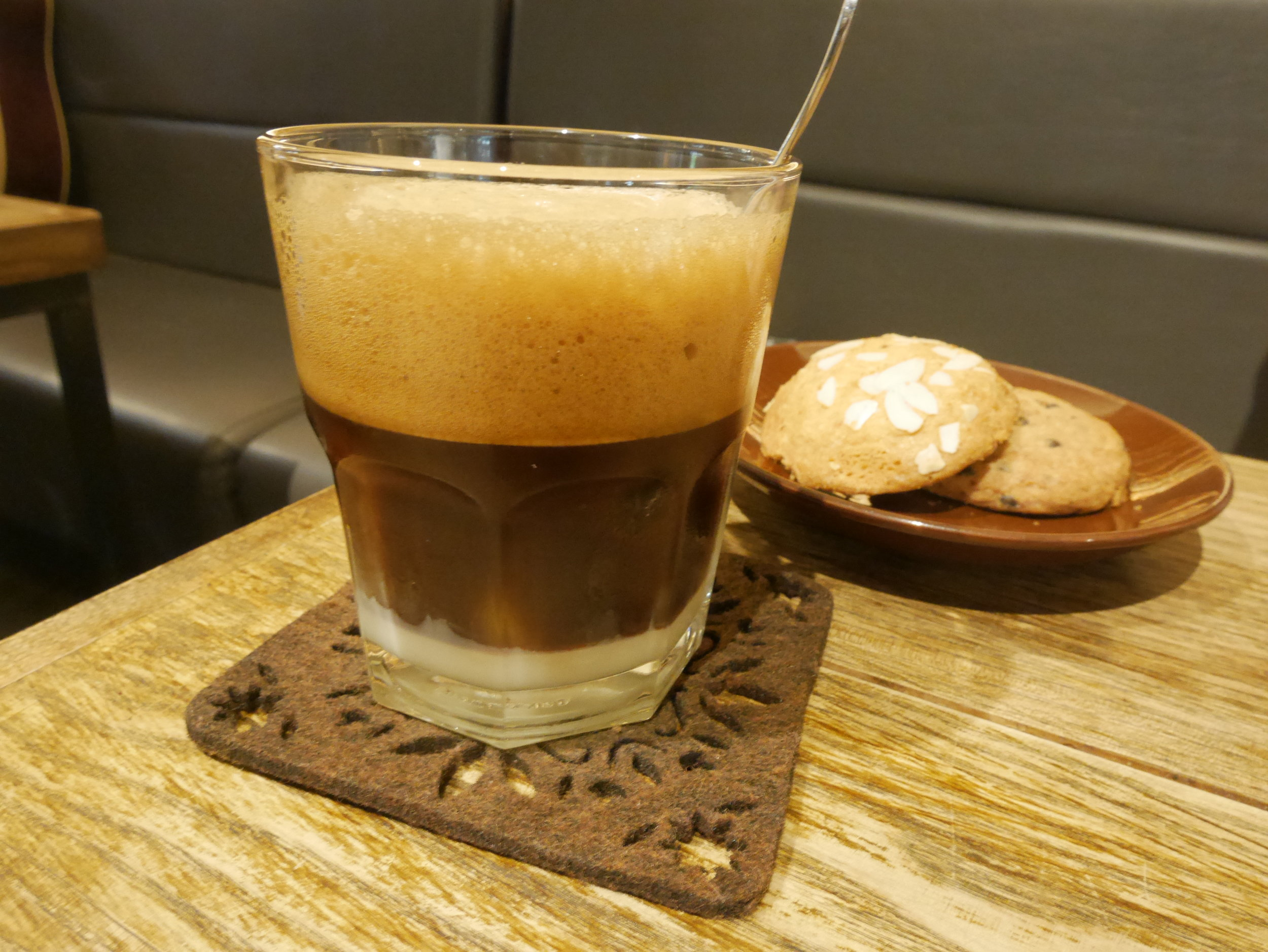3 layers served of Vietnamese coffee with condense milk and cookies