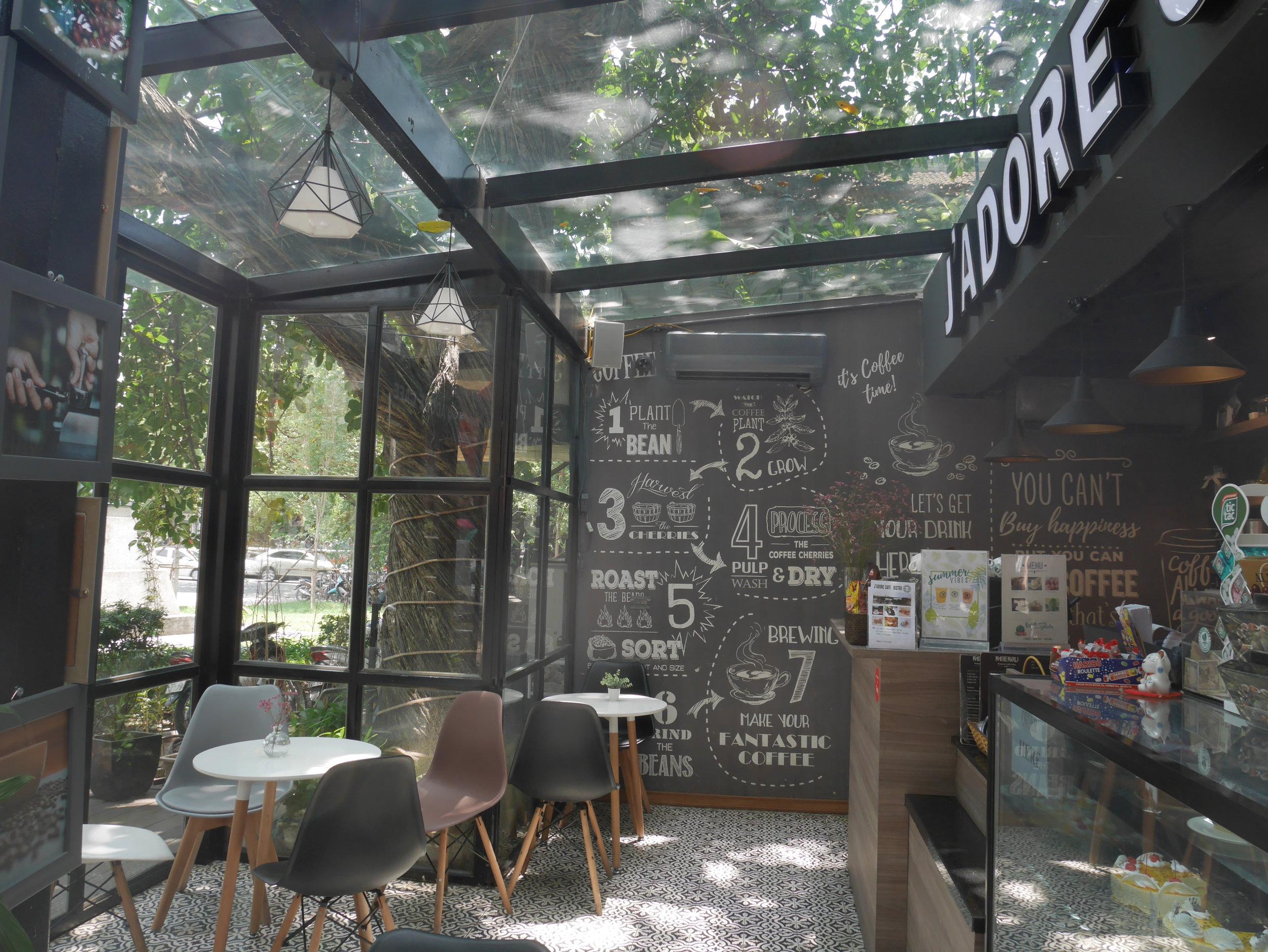 Inside J'Adore cafe. Loos like a little glass house.