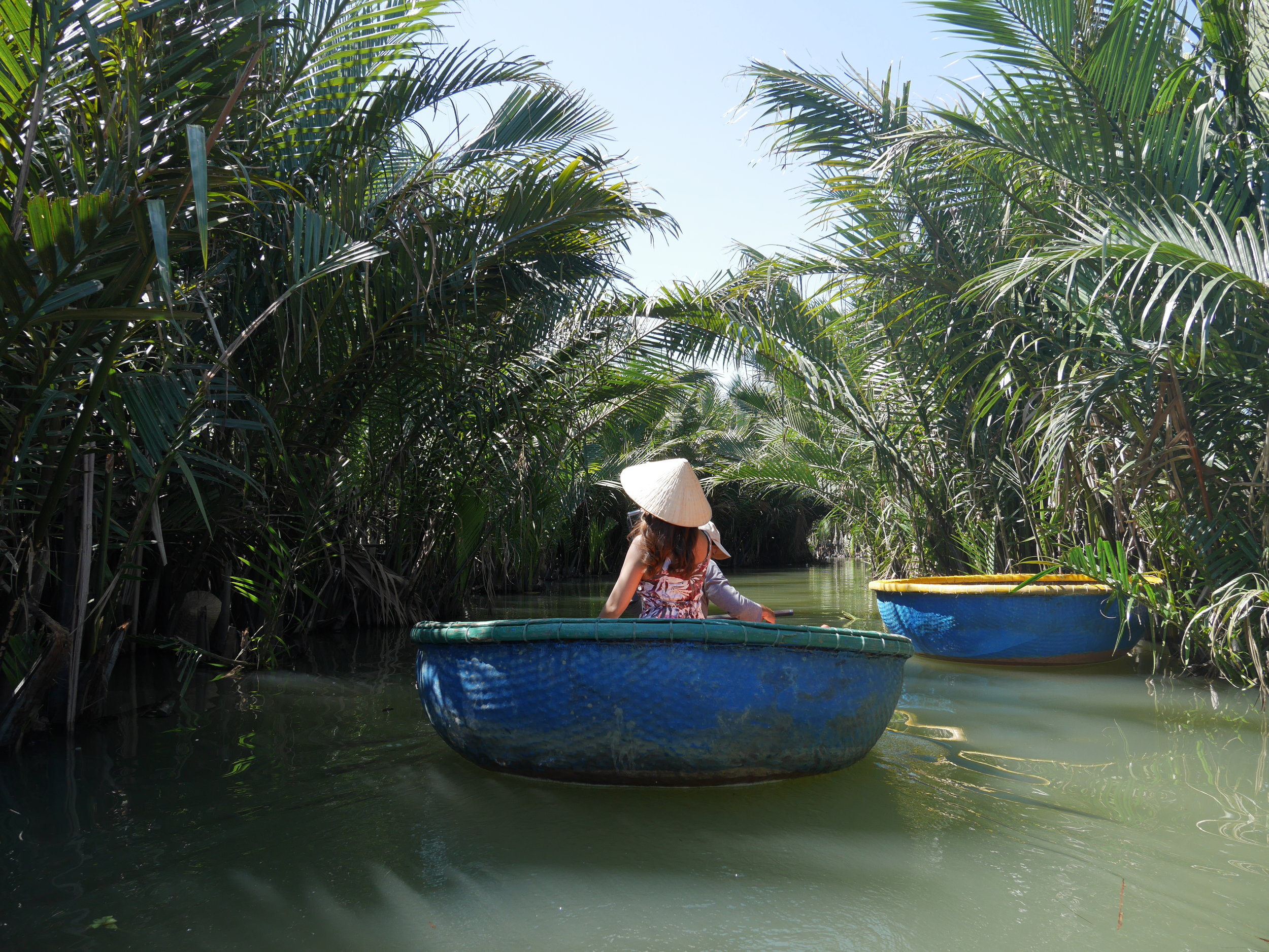Hoi An Coconut Basket Boat on Thu Bon River, along with water coconut forest