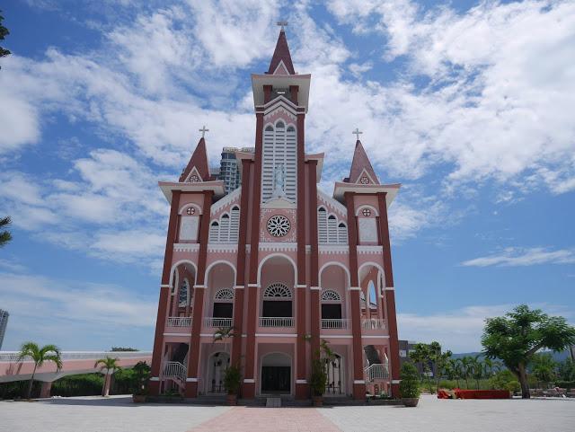 a beautiful pink church along the river in Da Nang, Vietnam