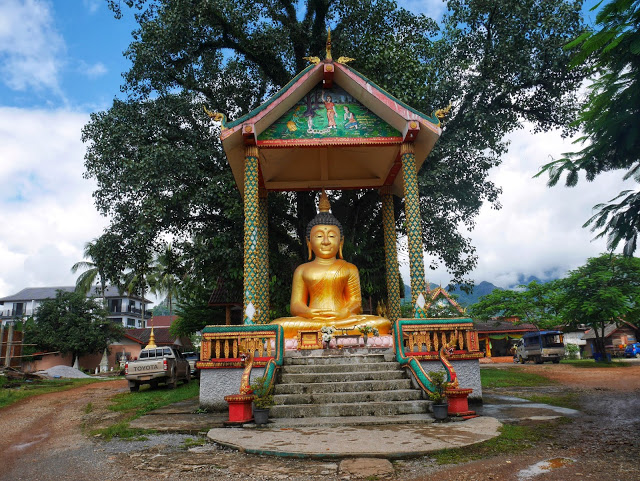 a statue of the Buddha at a temple in Vang Vieng, Laos