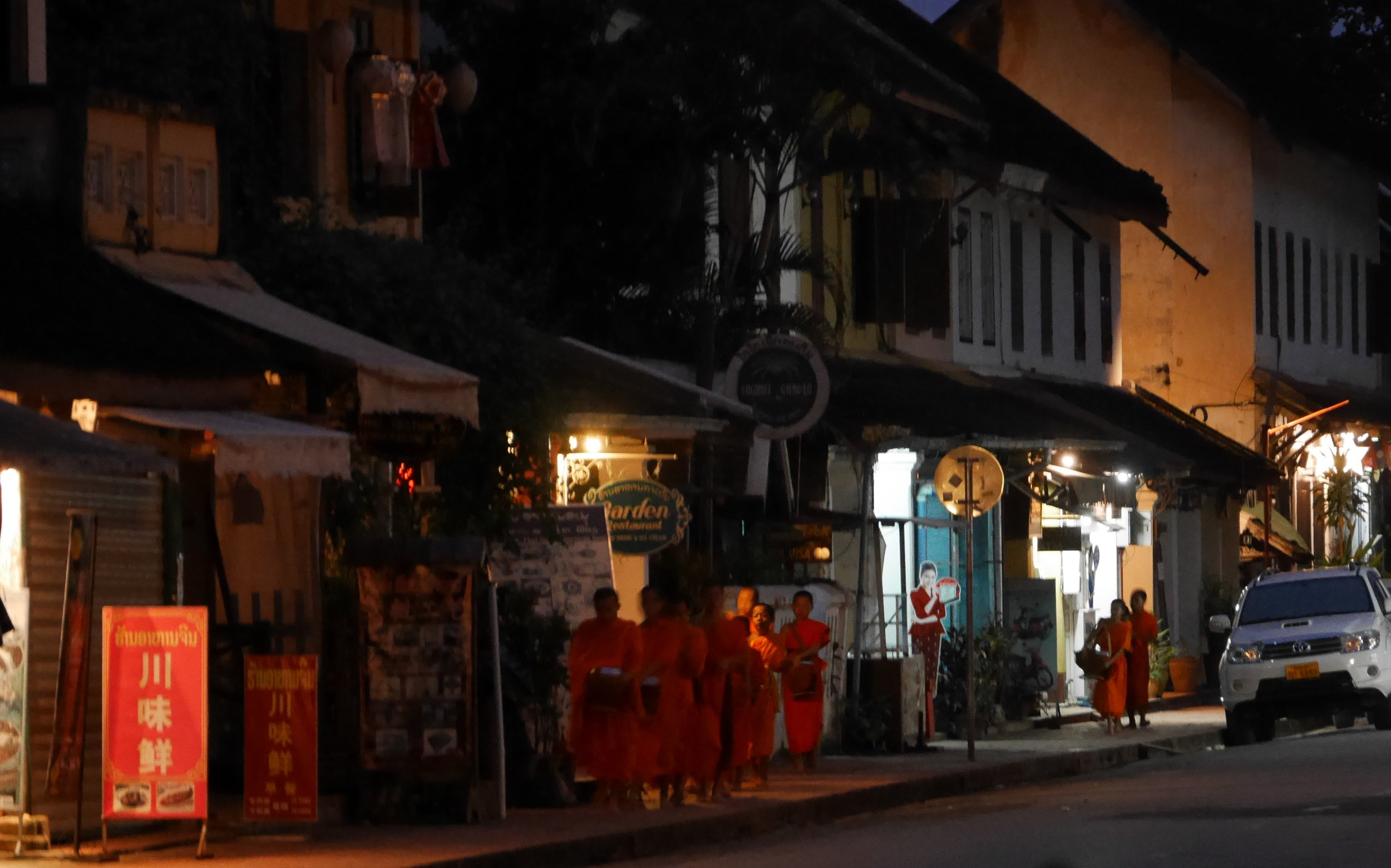 the morning alms giving ceremony begins before first light in Luang Prabang
