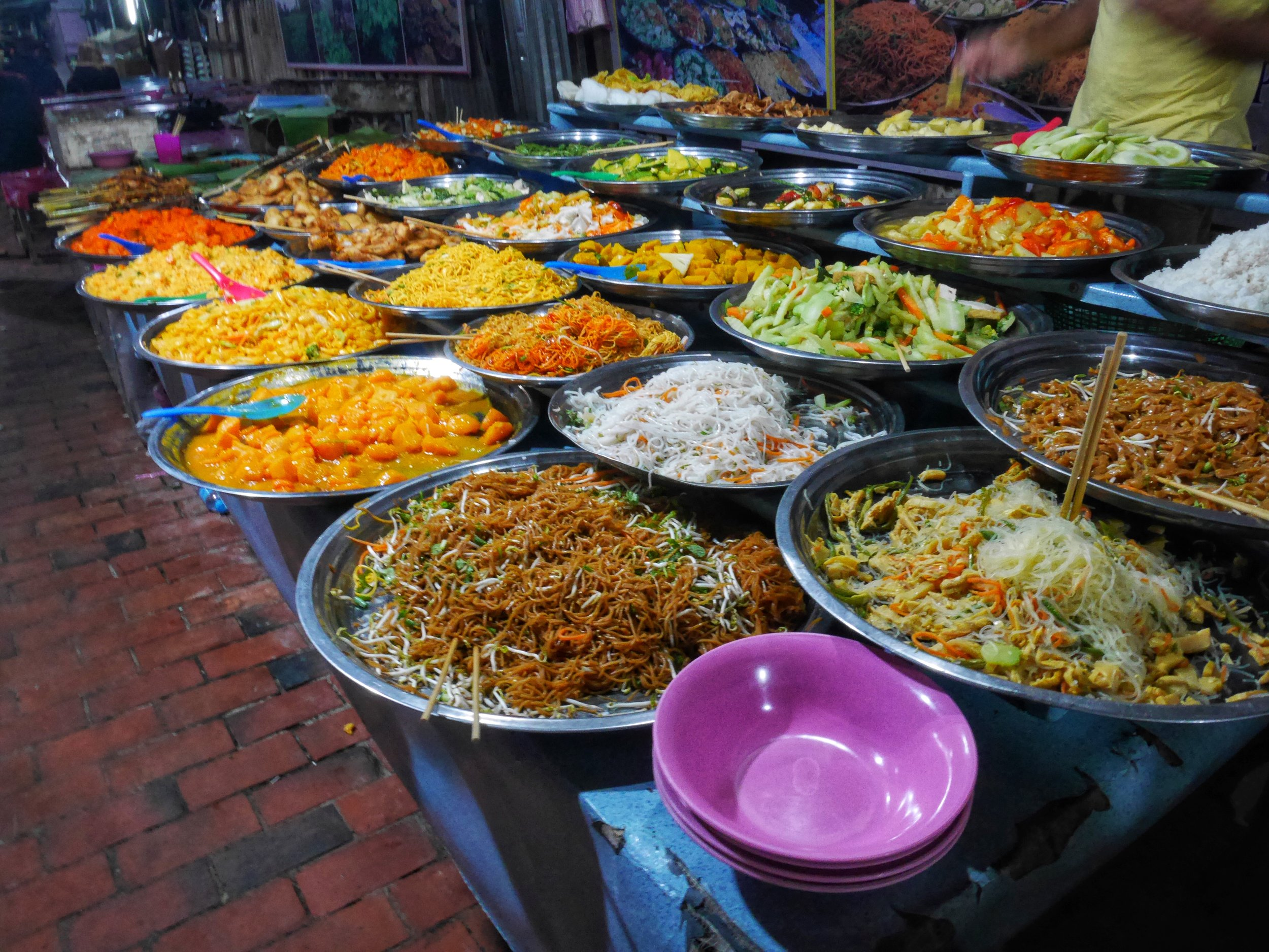 delicious and colorful dishes available at the Luang Prabang Night Market's famous vegetarian buffet