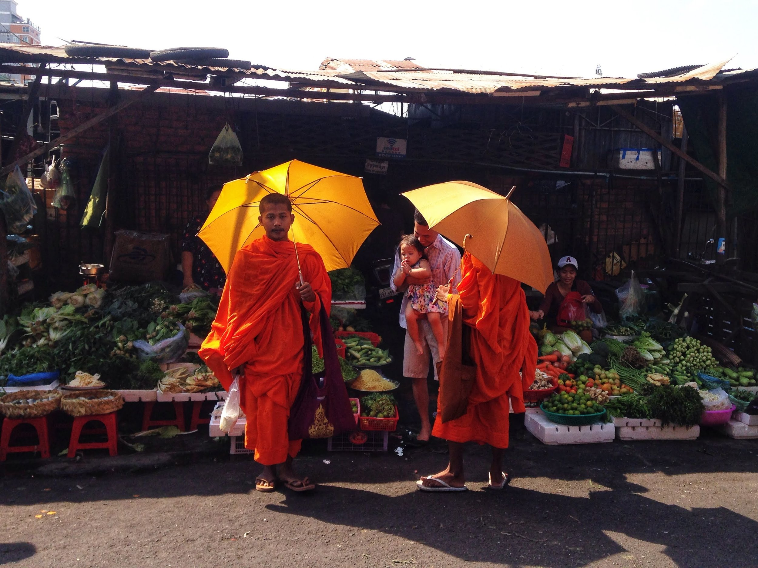 Buddhist monks collecting alms at the Russian Market in Phnom Penh
