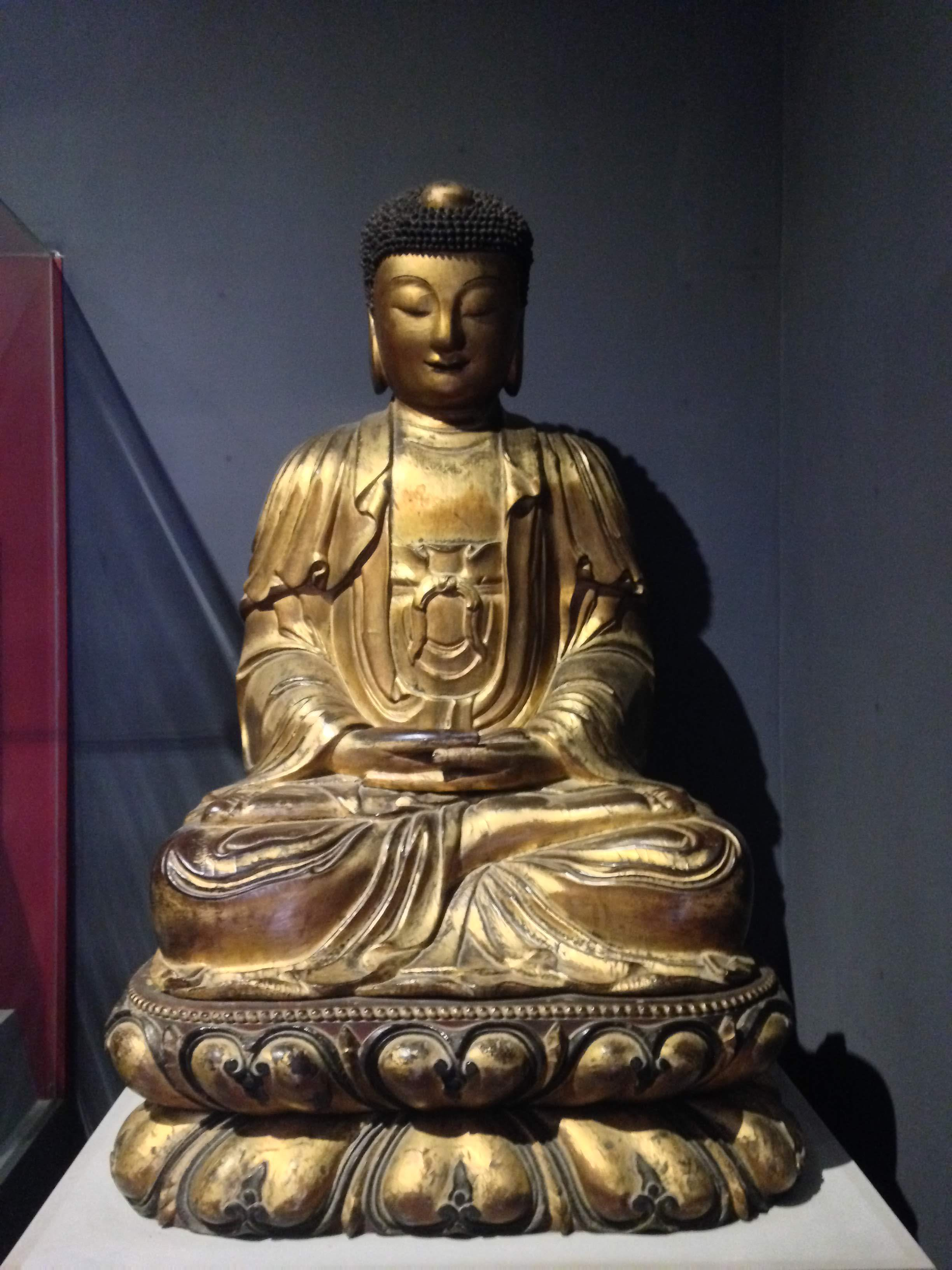 a historic Buddha statue inside the Ho Chi Minh Museum of Vietnamese History