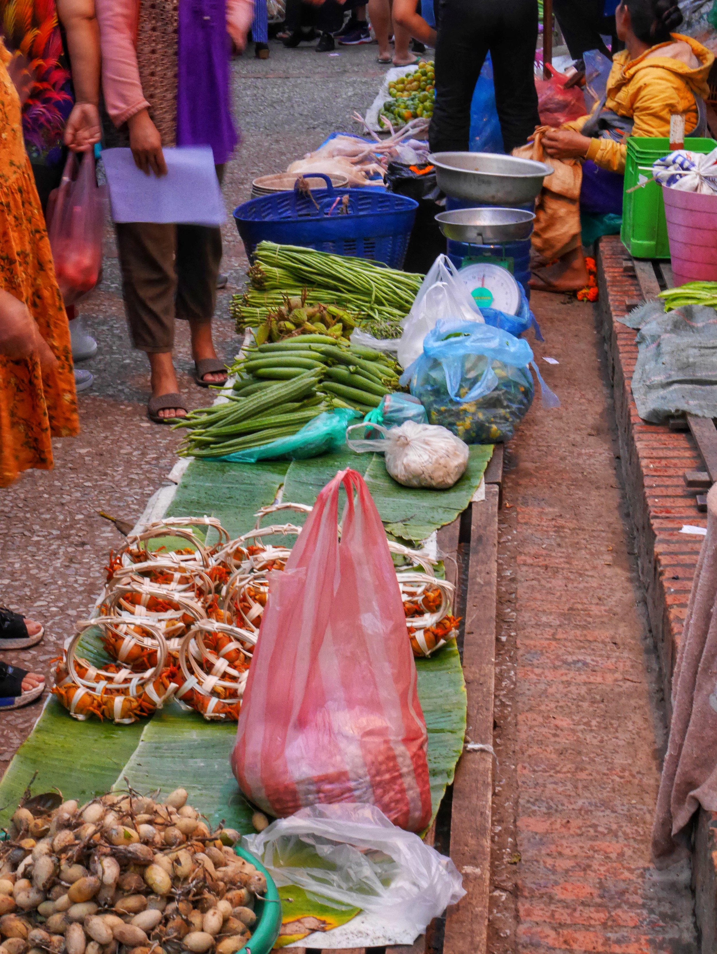 live crabs for sale along with various produce at Luang Prabang's Morning Market