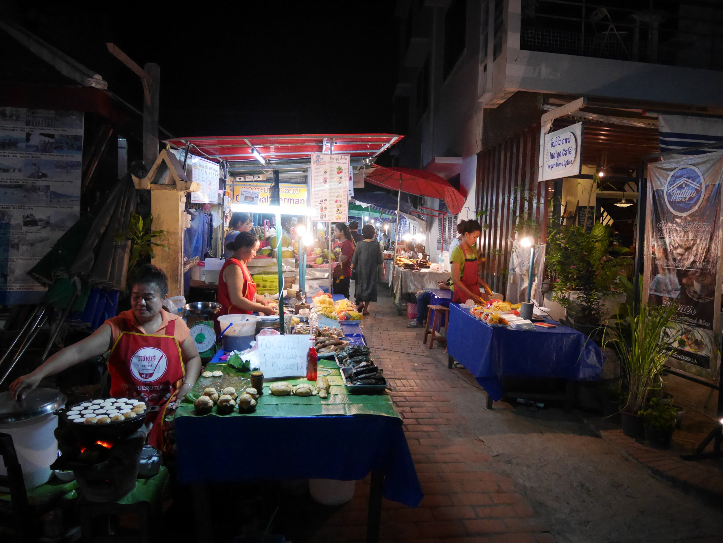 street vendors preparing food and snacks at the Night Market in Luang Prabang, Laos