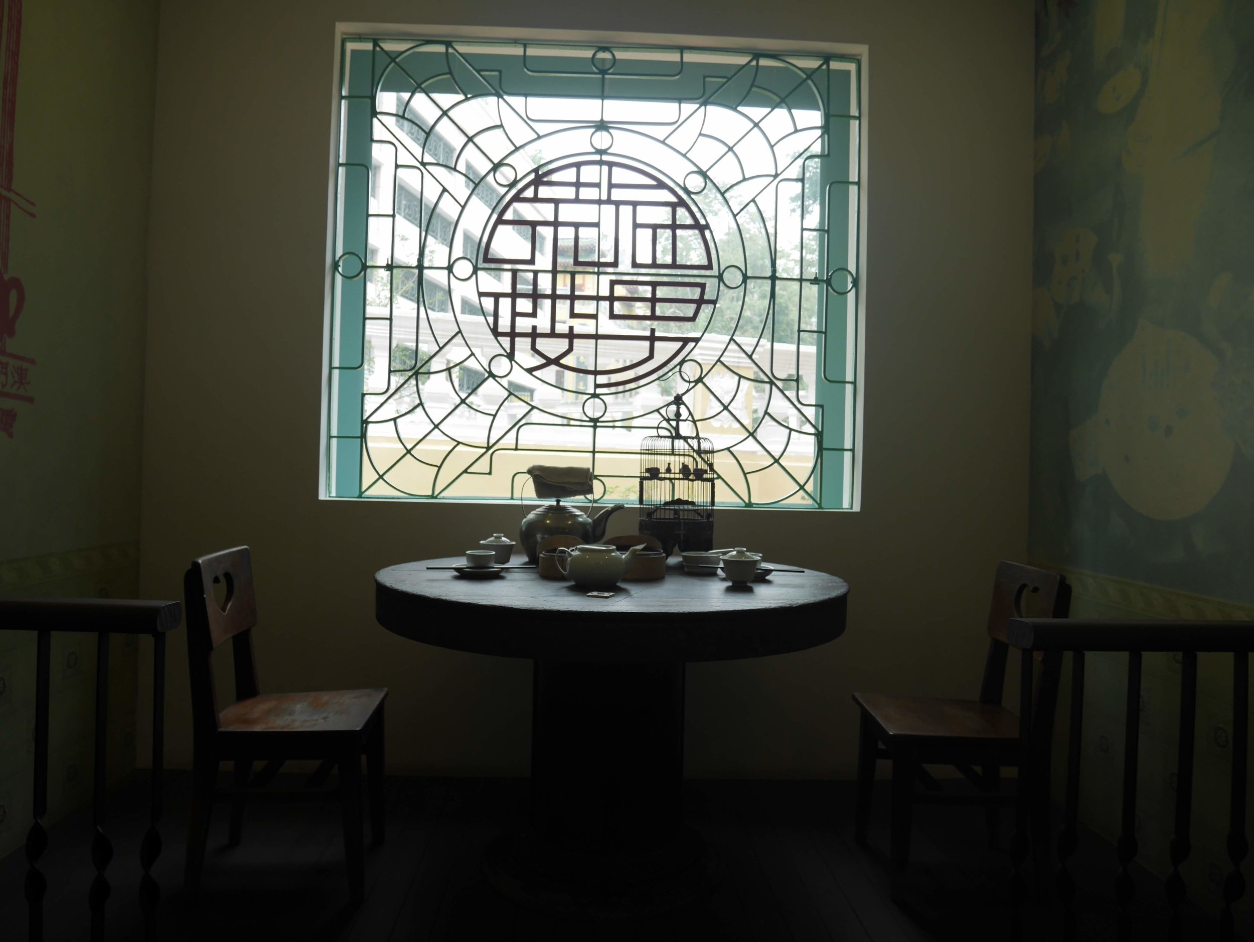 a traditional Chinese tea set inside the Tea Culture House Museum