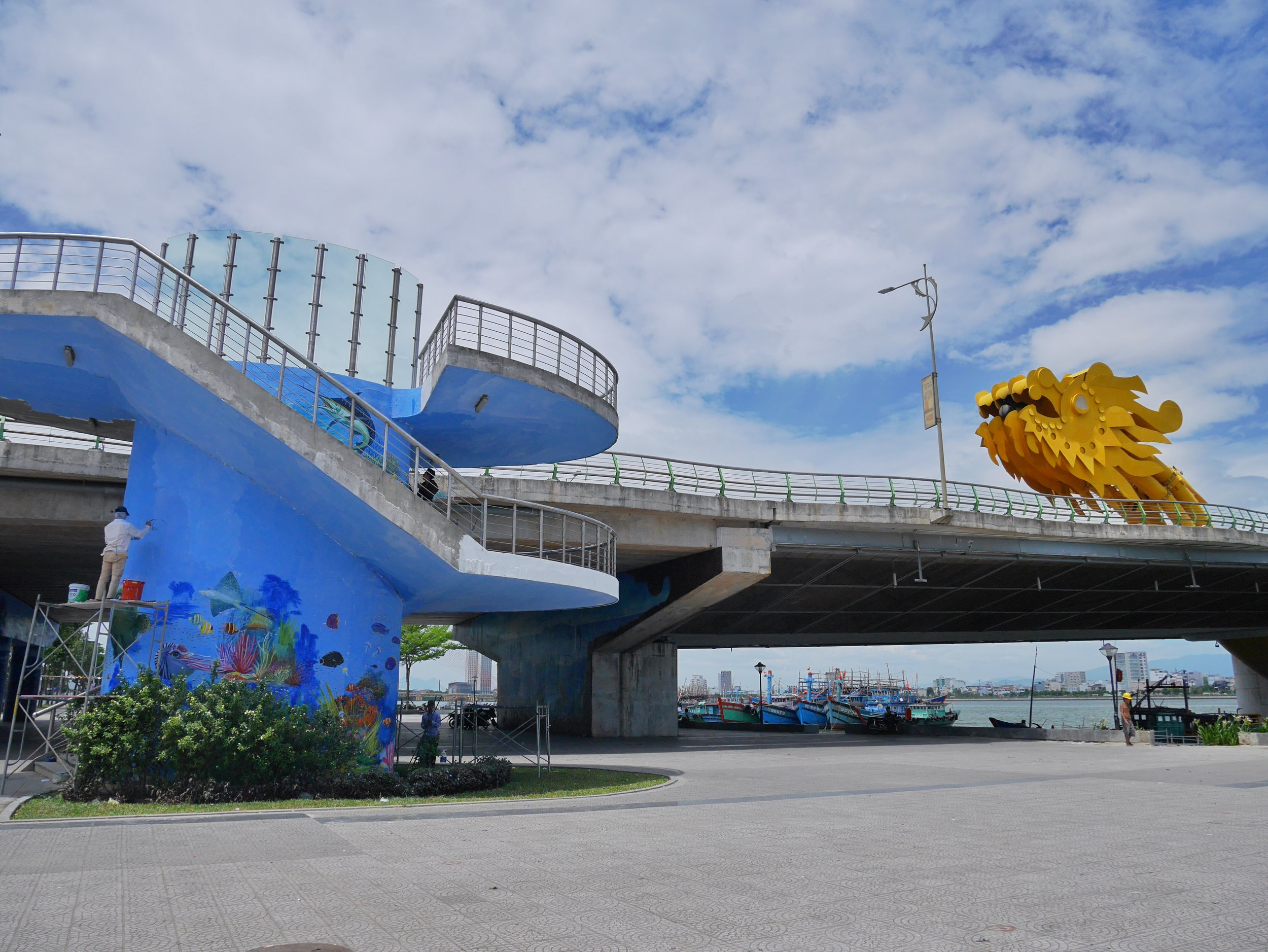 local artists painting undersea designs on the bridge over the Han River, Da Nang, Vietnam