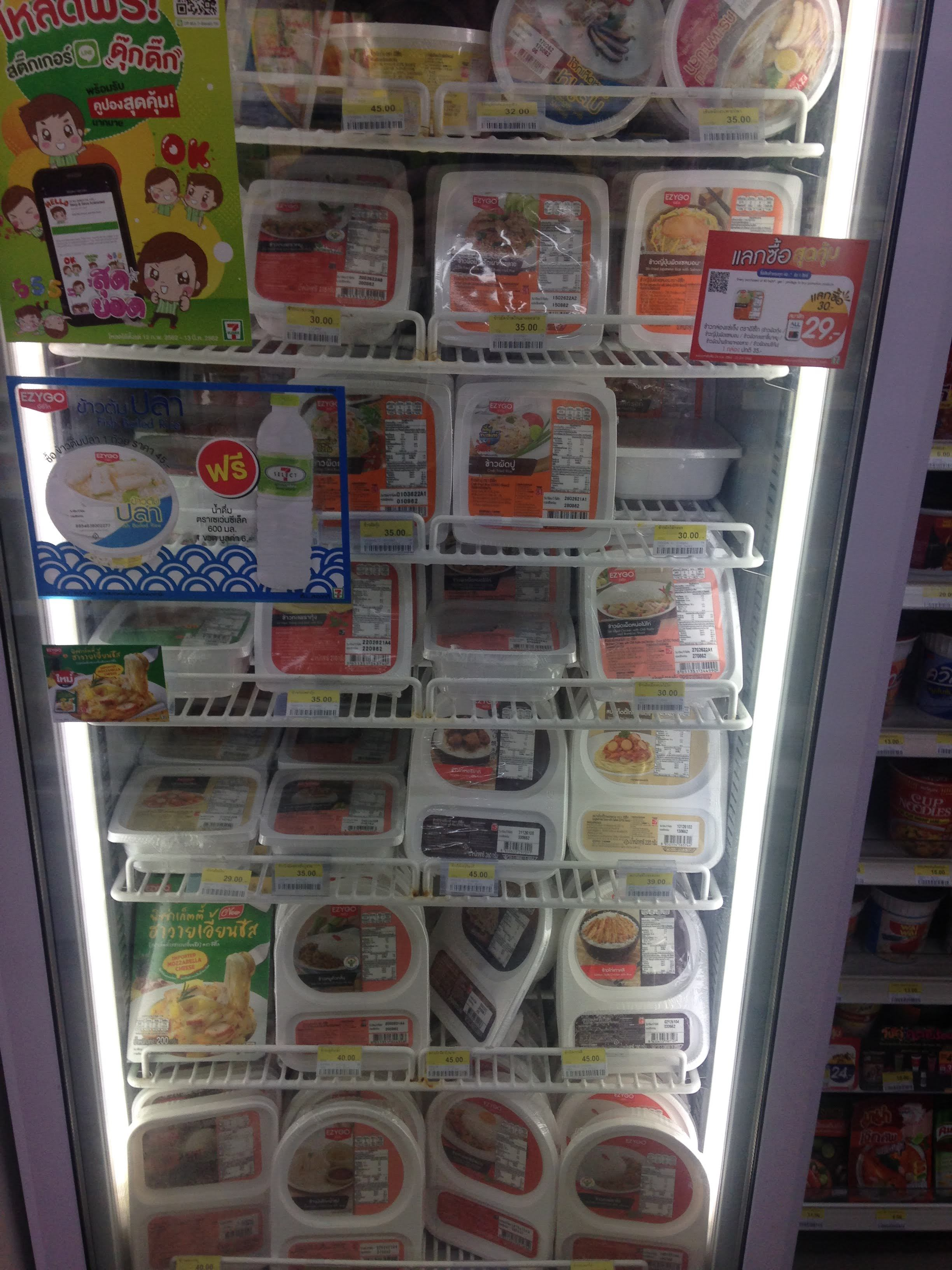 Frozen meals at 7-Eleven in Thailand usually cost 40-50 THB. The employees will re-heat them for you!
