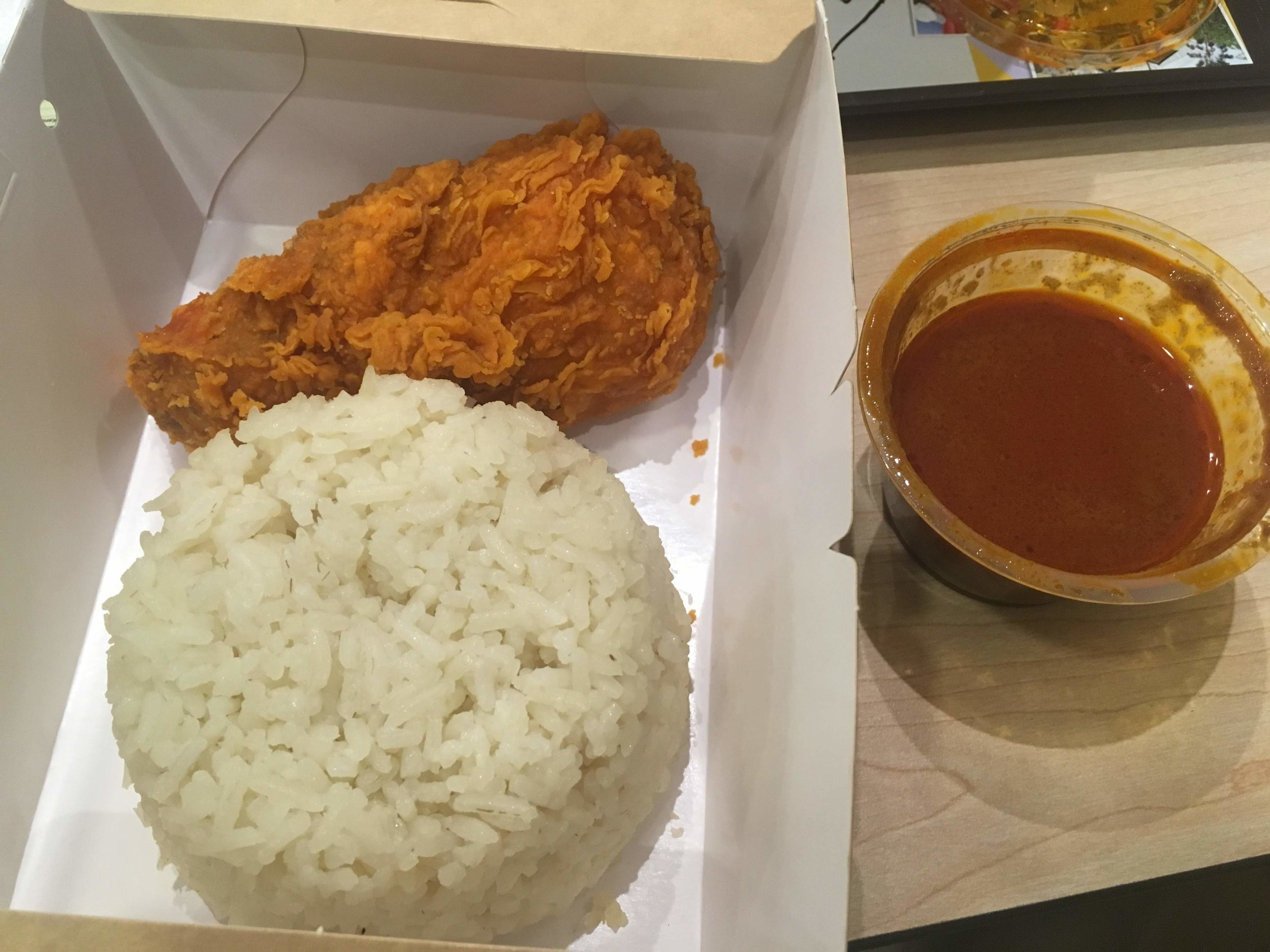 Ayam Goreng McD (spicy chicken and rice) ordered at a McDonald's in Kuala Lumpur, Malaysia