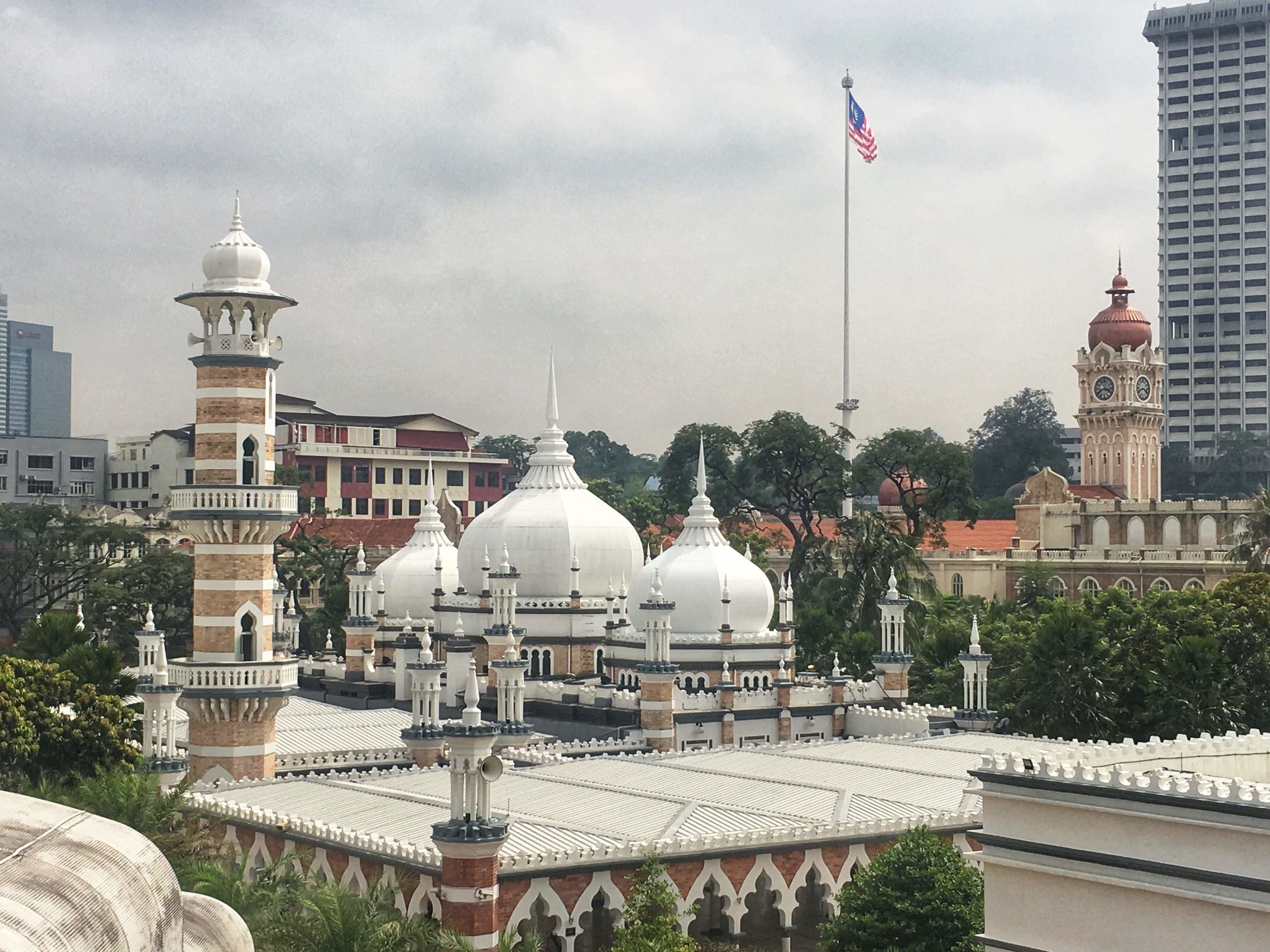 rooftop of Masjid Jamek with the Malaysian flag flying in the background