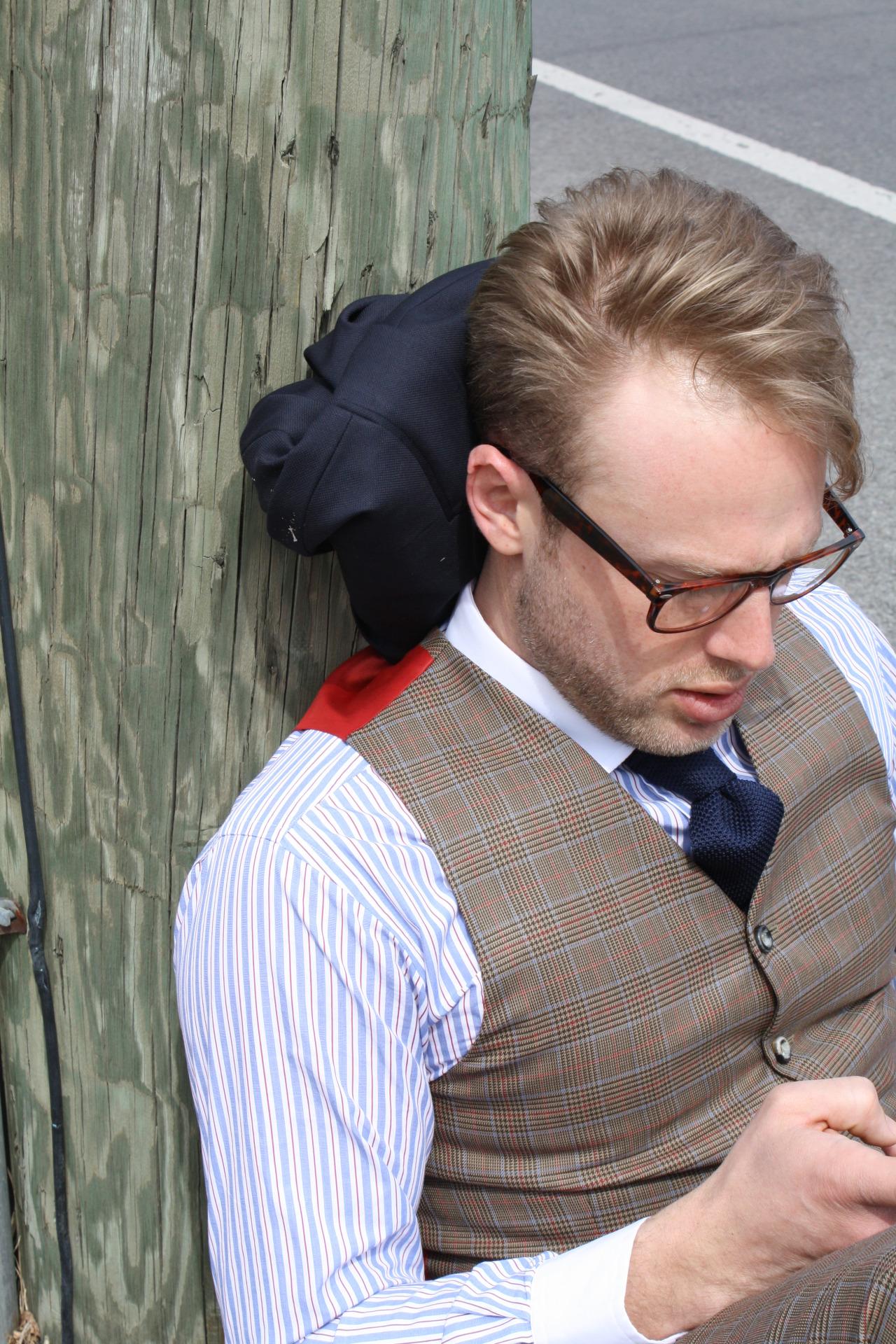 bespoke suit travel suit glasses blue striped shirt