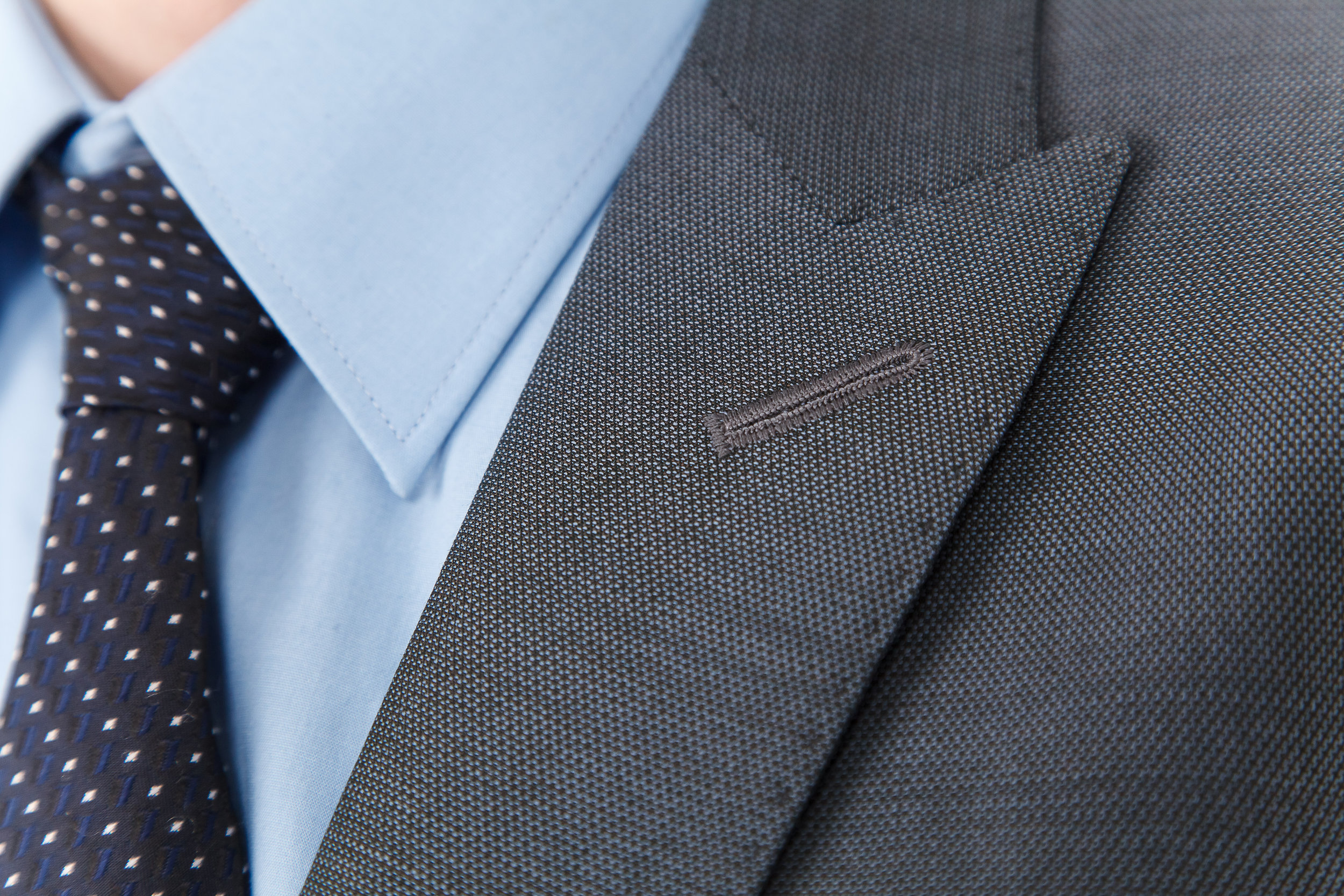 gray custom suit in cotton with blue cotton shirt
