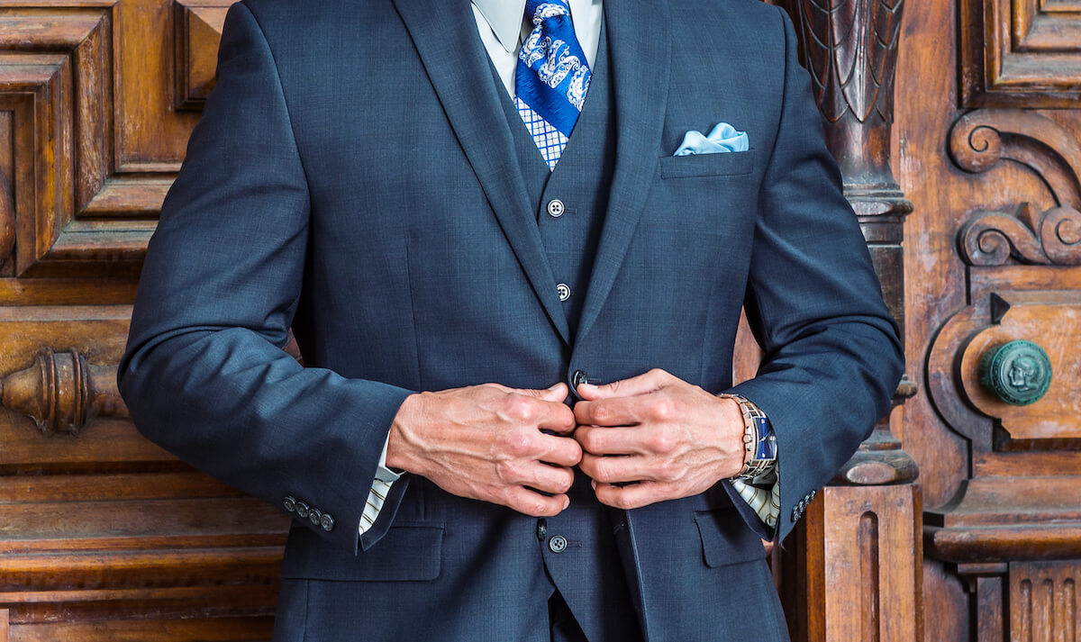 Blue gray suit with pocket square in a two pointed fold