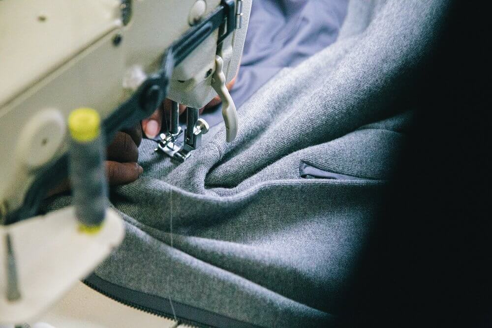 A tailor in Nashville sewing a jacket