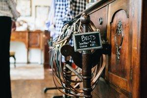 a rack of custom belts in nashville