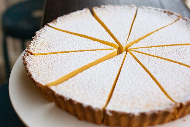 Our lemon tart - you'll fall in love at first bite 💛🍋 Available for order, half or whole (see our website for details).