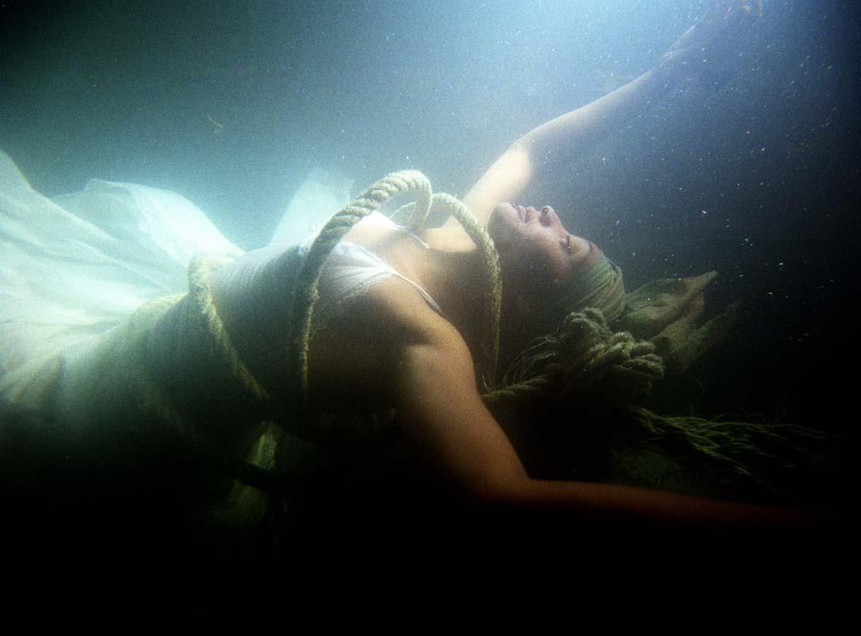 """Drowning Slave. A piece inspired by a collaborative performance project on slavery in the Cape, entitled """"Cargo"""", by Magnet Theatre and Jazzart Dance Theatre. Image by the late photographer Garth Stead. Circa 2008."""