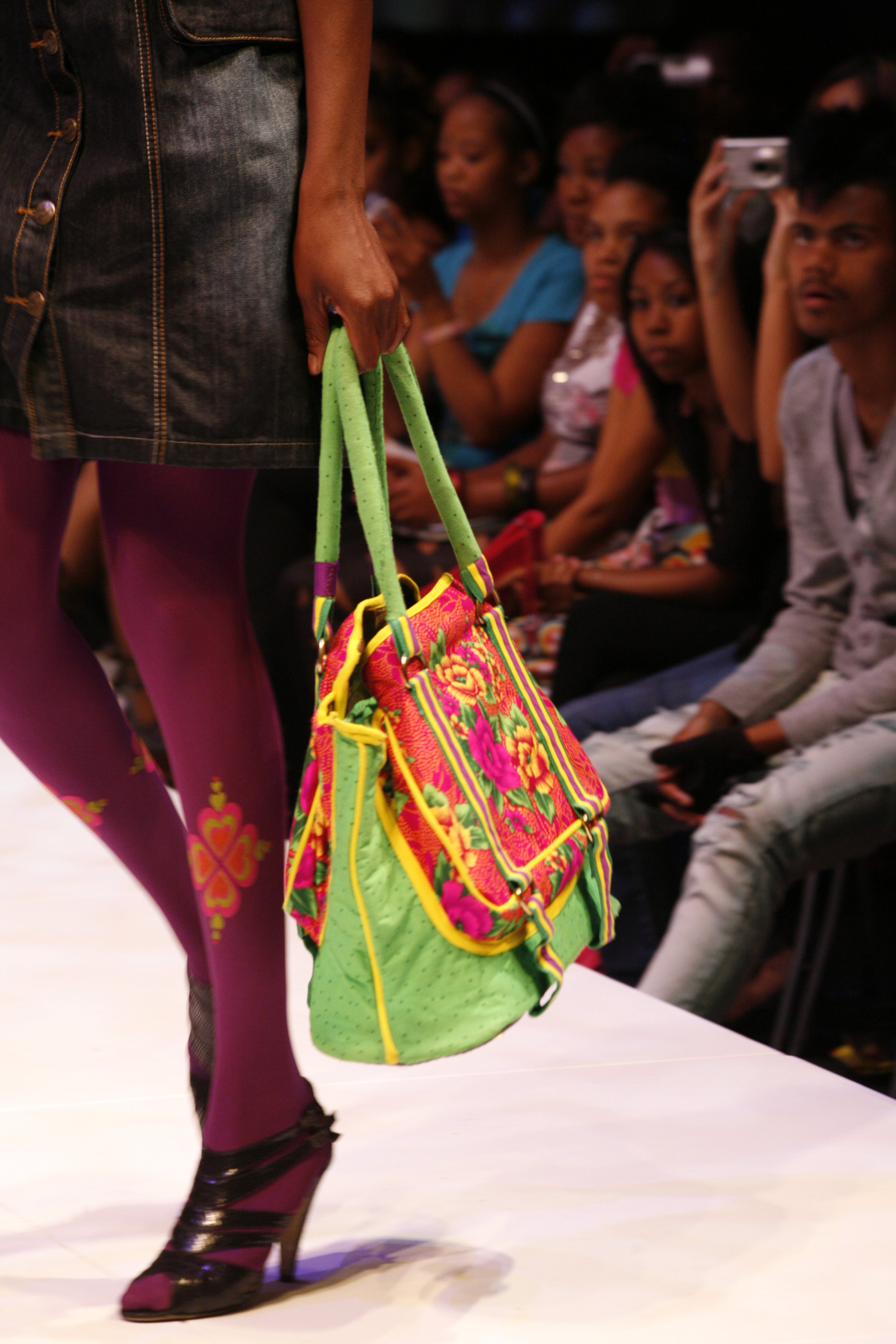 a model on the catwalk at Design Indaba 2008, showing off locally made design accessories. this and the following colour photos by Anita Van Zyl
