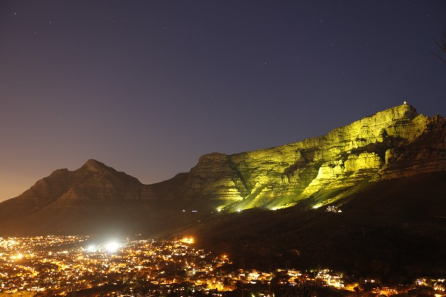 Table Mountain lit with the bid's yellow shade