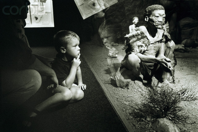 """The controversial (and no longer of display) """"Bushmen"""" diorama at the South African Museum, which was made from human casts, in an evocative photo by  Gideon Mendel . The making of the diorama is reflective of the ways in which colonialists misused their power in their research and categorisation of the Other."""
