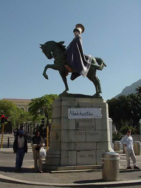 Abakhwetha: a public art intervention by Beezy Bailey transforms a statue of an Afrikaner hero into a Xhosa initiate.   Part of the 1999 Public Eye, PTO initiative.  Photograph courtesy of Public Eye