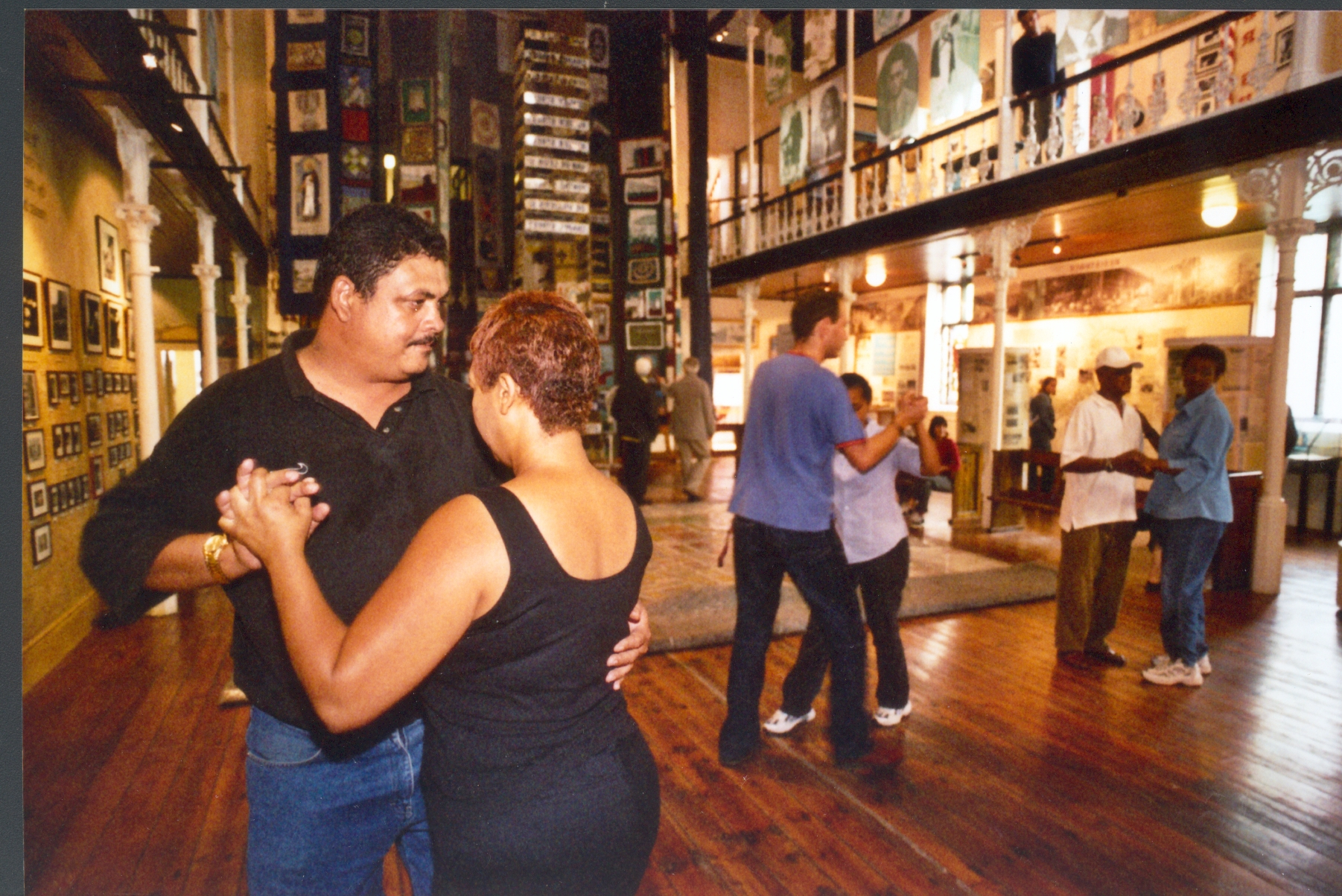 Square dancing in the District Six Museum, a community museum about forced removals in Cape Town.  Photograph Garth Stead
