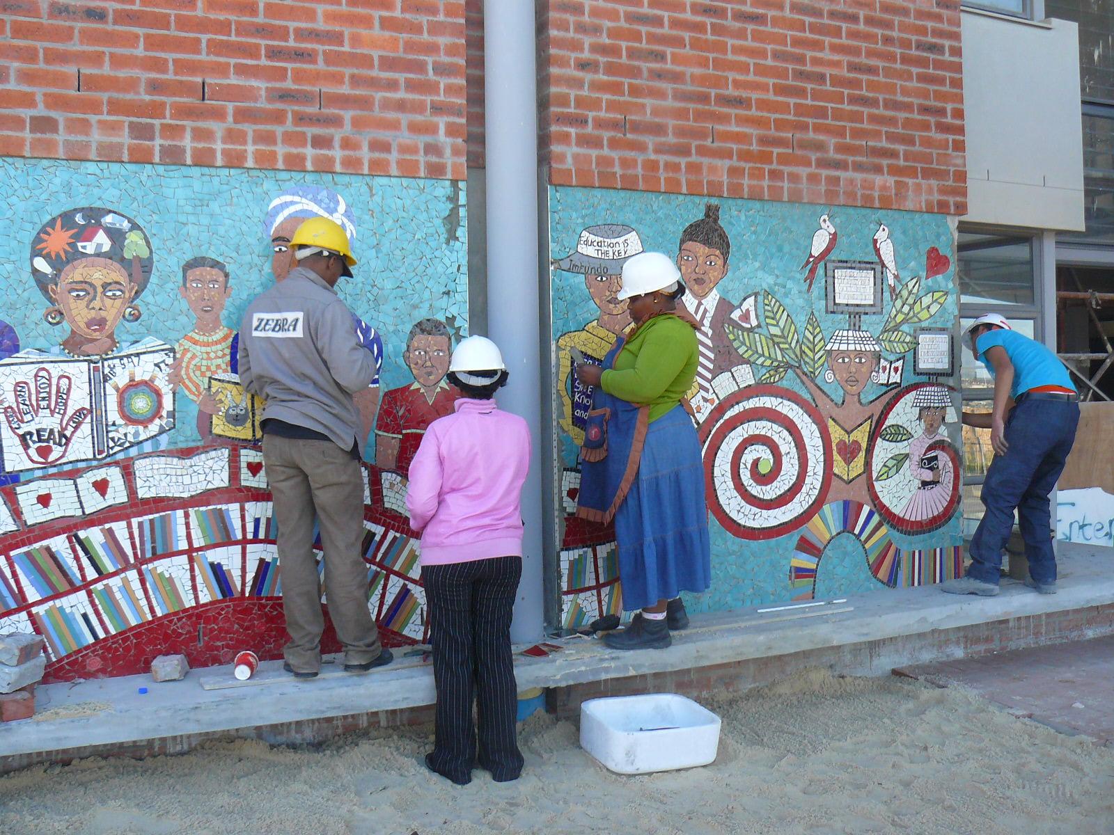A community designed ceramic mural at the VPUU project. photo Alex Jongens