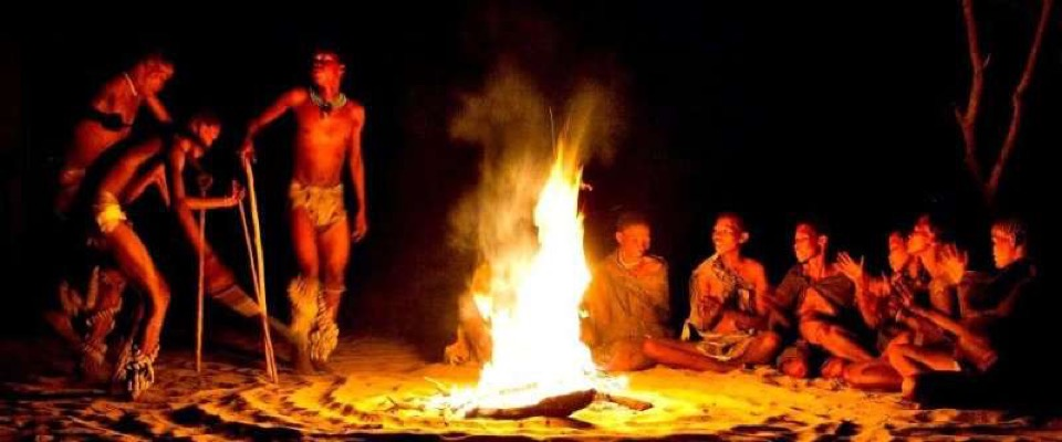Indigenous people around a campfire .  uncredited photo on the internet
