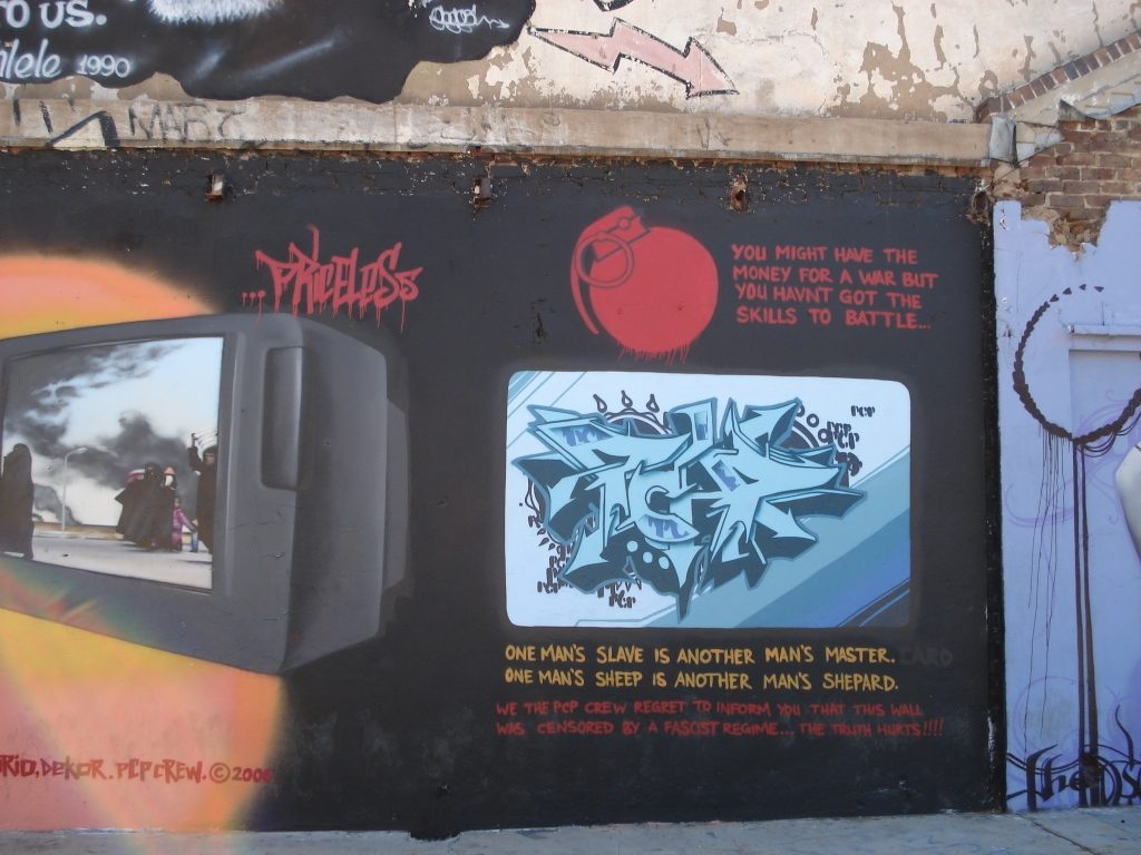 "A contentious mural which appeared in 2006 - critical of consumerism and its agents of power. It had at this point in 2007 been ""censored""."