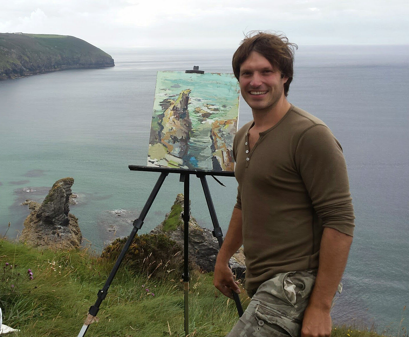 In Cornwall on the cliffs by St Agnes, painting an odd shaped rock
