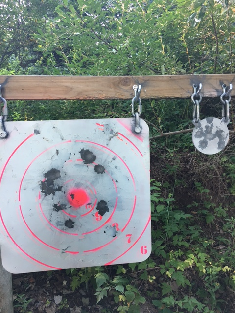 """At 600 yards, we use a 24"""" target for getting zeroed and iron sights, and a 6"""" for a challenge with our more accurate rifles. Both are 3/8"""" AR500. The scoring rings are applied with a stencil, and mimic the 600-yard F-class target center."""