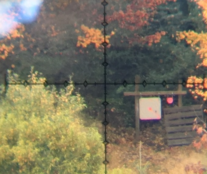 The splash from a 6.5 Creedmoor at 600 yards is very obvious, even in this grainy cell-phone-through-the-scope photo. With my eye to the scope, the scoring rings and numbers (barely visible at all here) are clear and legible.